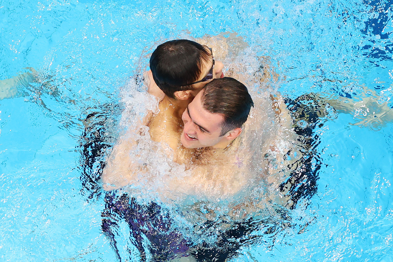 Russian swimmers Evgeny Rylov andKliment Kolesnikov celebrate after finishing first and second respectively in the 100m backstroke final on July 27.