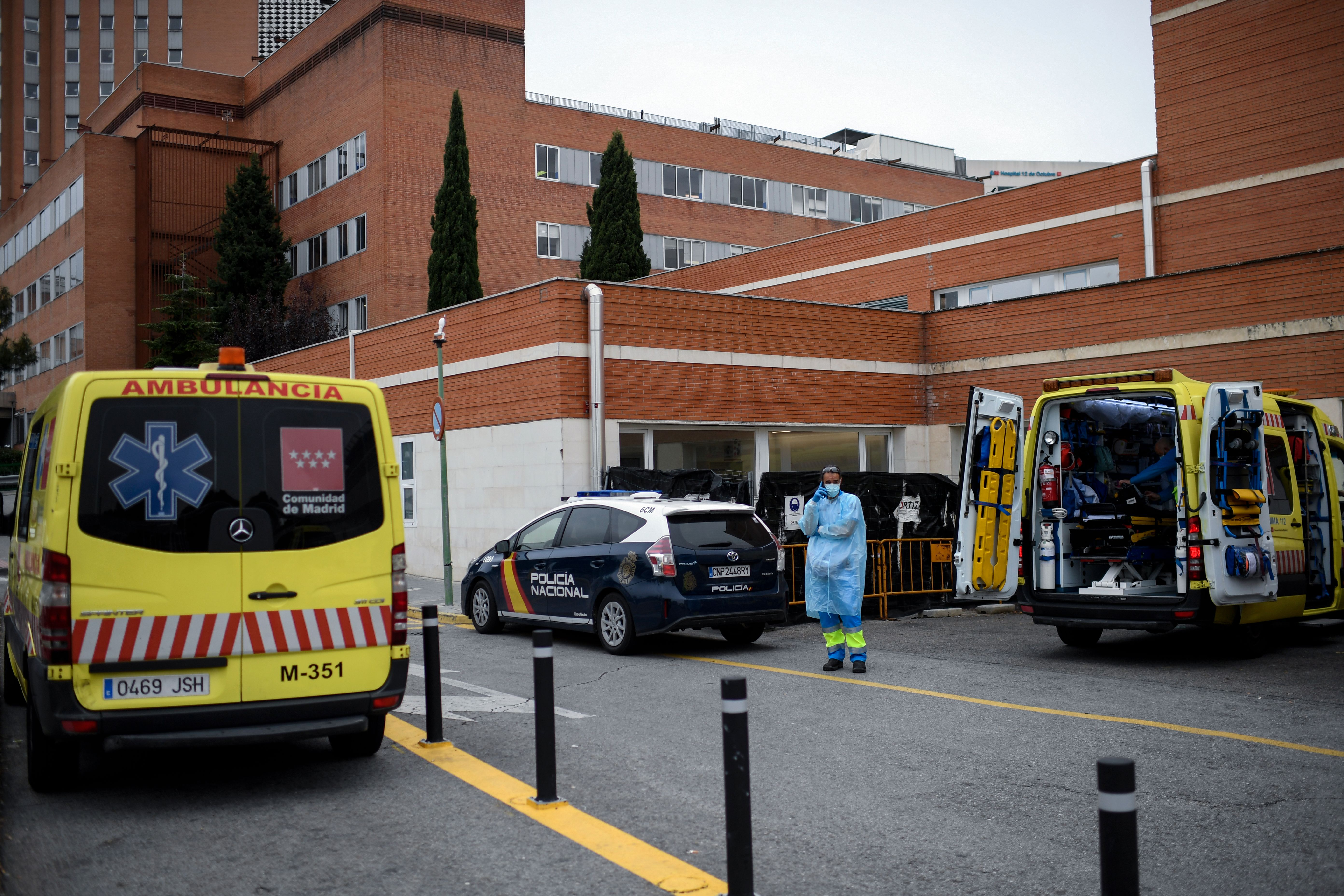 A healthcare worker wearing protective gear uses a mobile phone at the 12 de Octubre hospital in Madrid, amid the coronavirus (COVID-19) pandemic, on October 28, 2020.