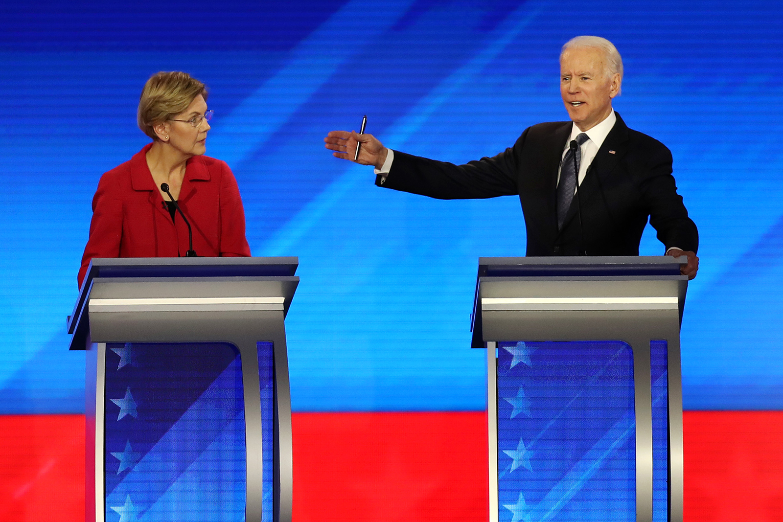 Democratic presidential candidates Sen. Elizabeth Warren and former Vice President Joe Biden participate in the Democratic presidential primary debate in the Sullivan Arena at St. Anselm College on February 7, in Manchester, New Hampshire.