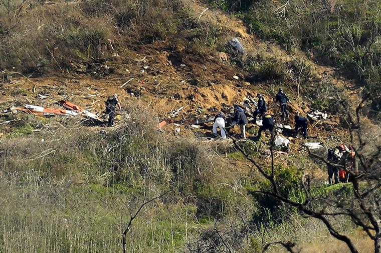 Investigators work the scene of the crash on Monday, January 27.
