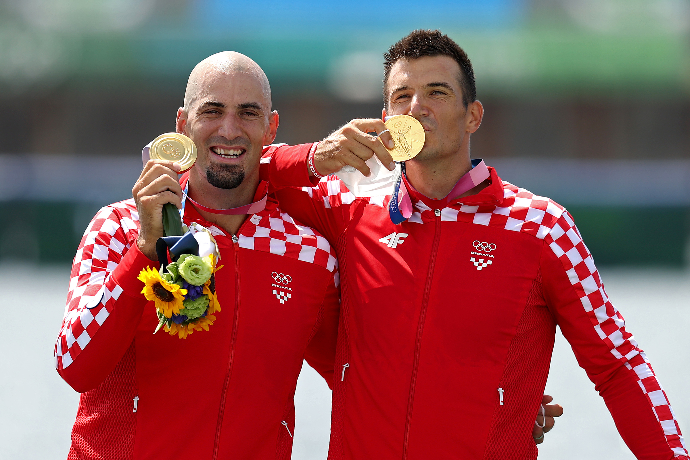 Brothers Martin Sinkovic and Valent Sinkovic of Team Croatia pose with their gold medals after the rowing men's pair final on July 29.