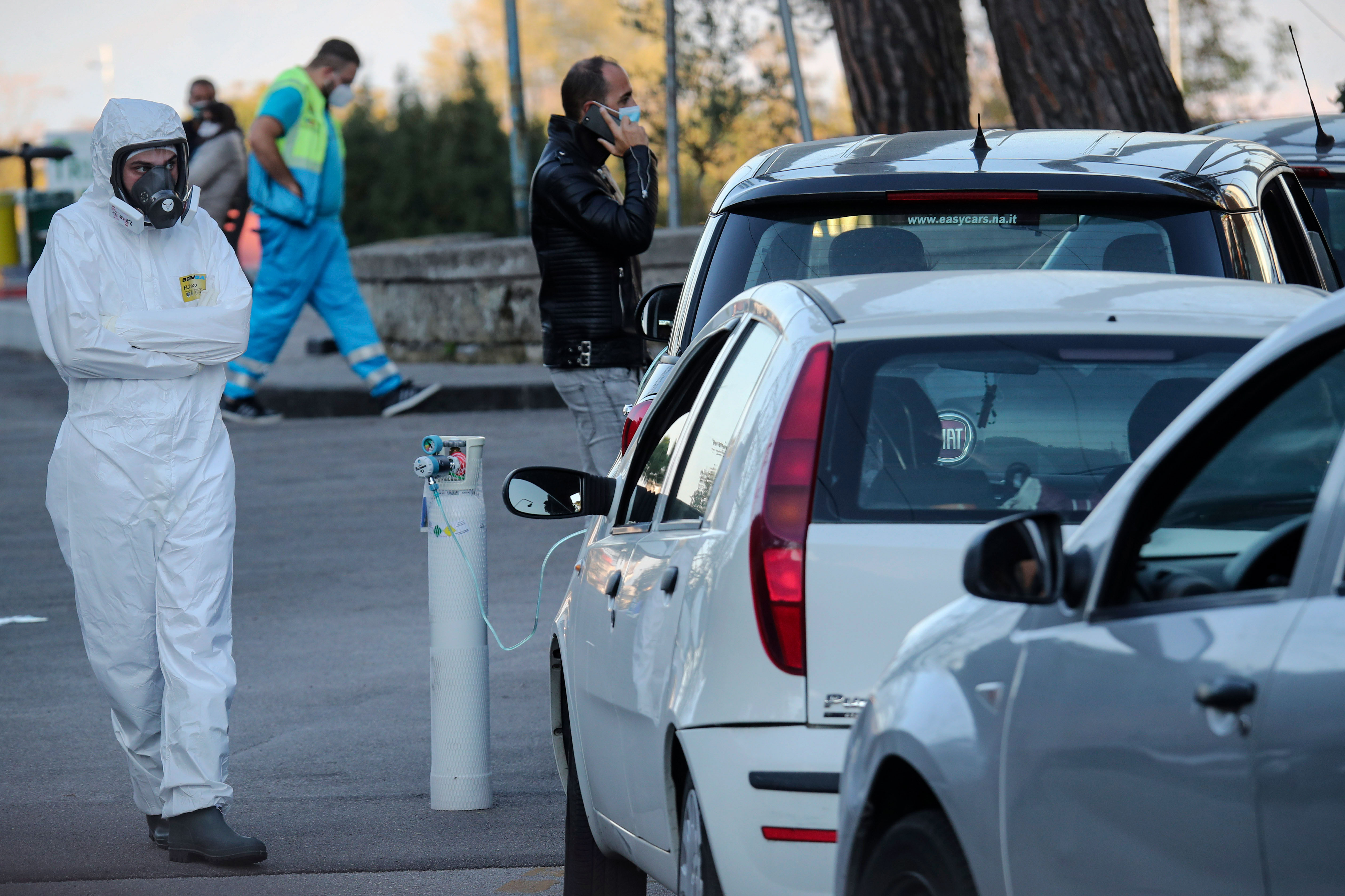 People with suspected cases of Covid-19 are treated in their cars at Cotugno hospital in Naples, Italy, on November 7.