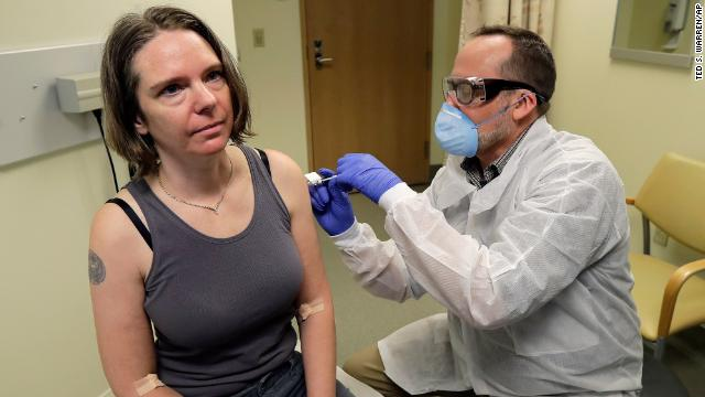 A pharmacist gives Jennifer Haller the first shot in the first-stage safety study clinical trial of a potential vaccine for Covid-19 on Monday, March 16, at the Kaiser Permanente Washington Health Research Institute in Seattle.
