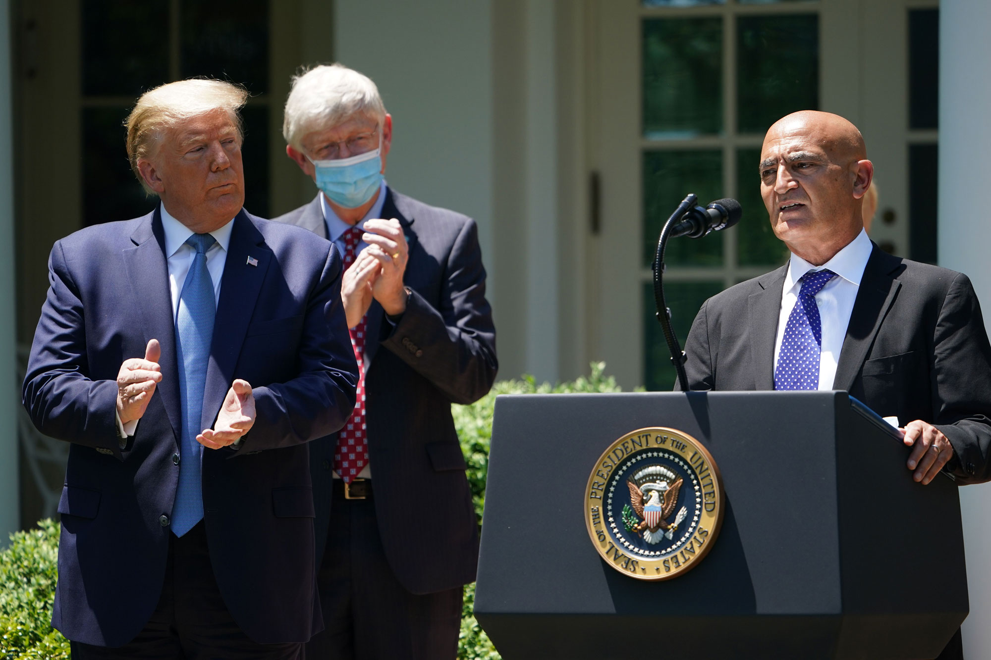 """Chief Adviser """"Warp Speed"""" vaccine effort Monecef Slaoui (R), with US President Donald Trump, speaks on vaccine development on May 15 in the Rose Garden of the White House in Washington."""