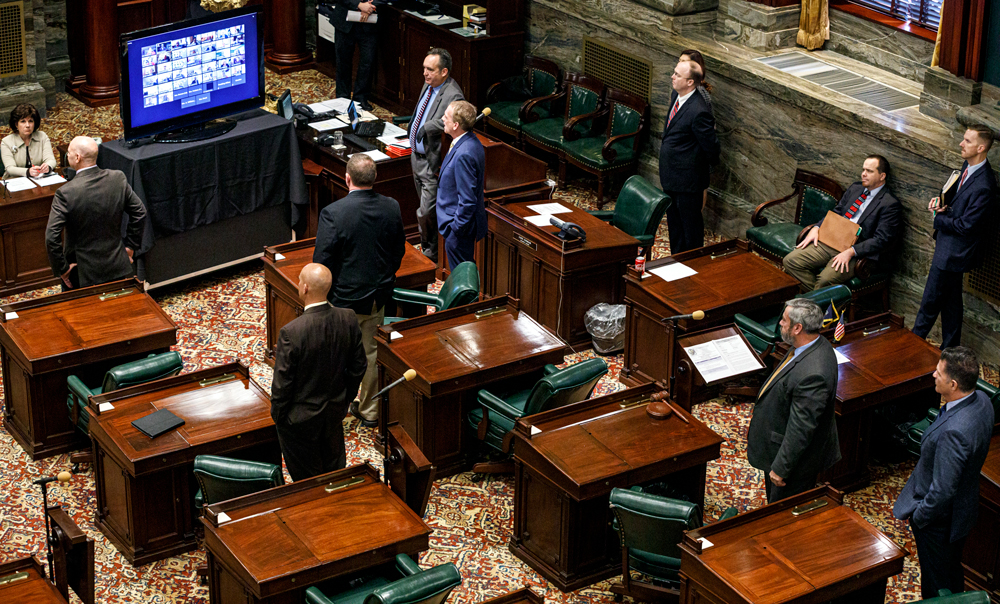 In this March 25, 2020 file photo, senators observe social distancing as other senators have live-streamed the senate session, in Harrisburg, Pennsylvania.