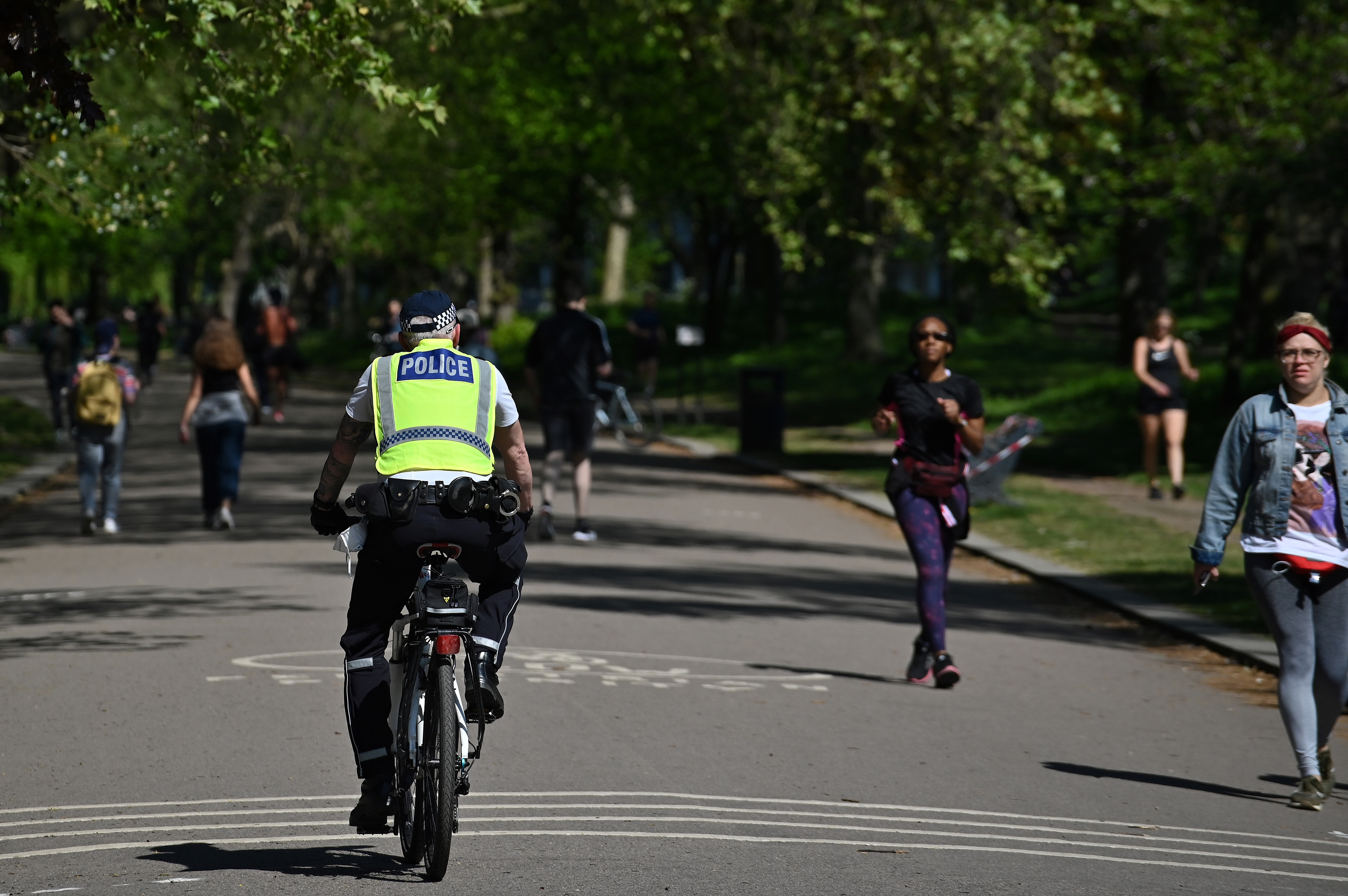 A police officer rides a bike as he patrols Victoria Park in London on April 25.