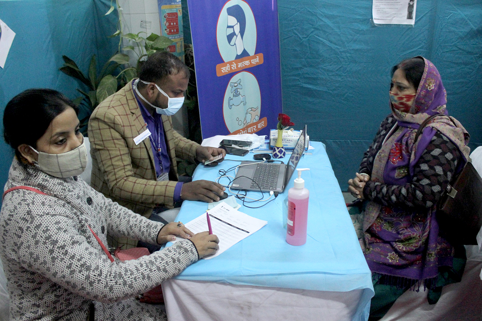 A vaccination officer registers a volunteer during a mock drill for Covid-19 vaccine delivery at a healthcare center in New Delhi, India on January 2.
