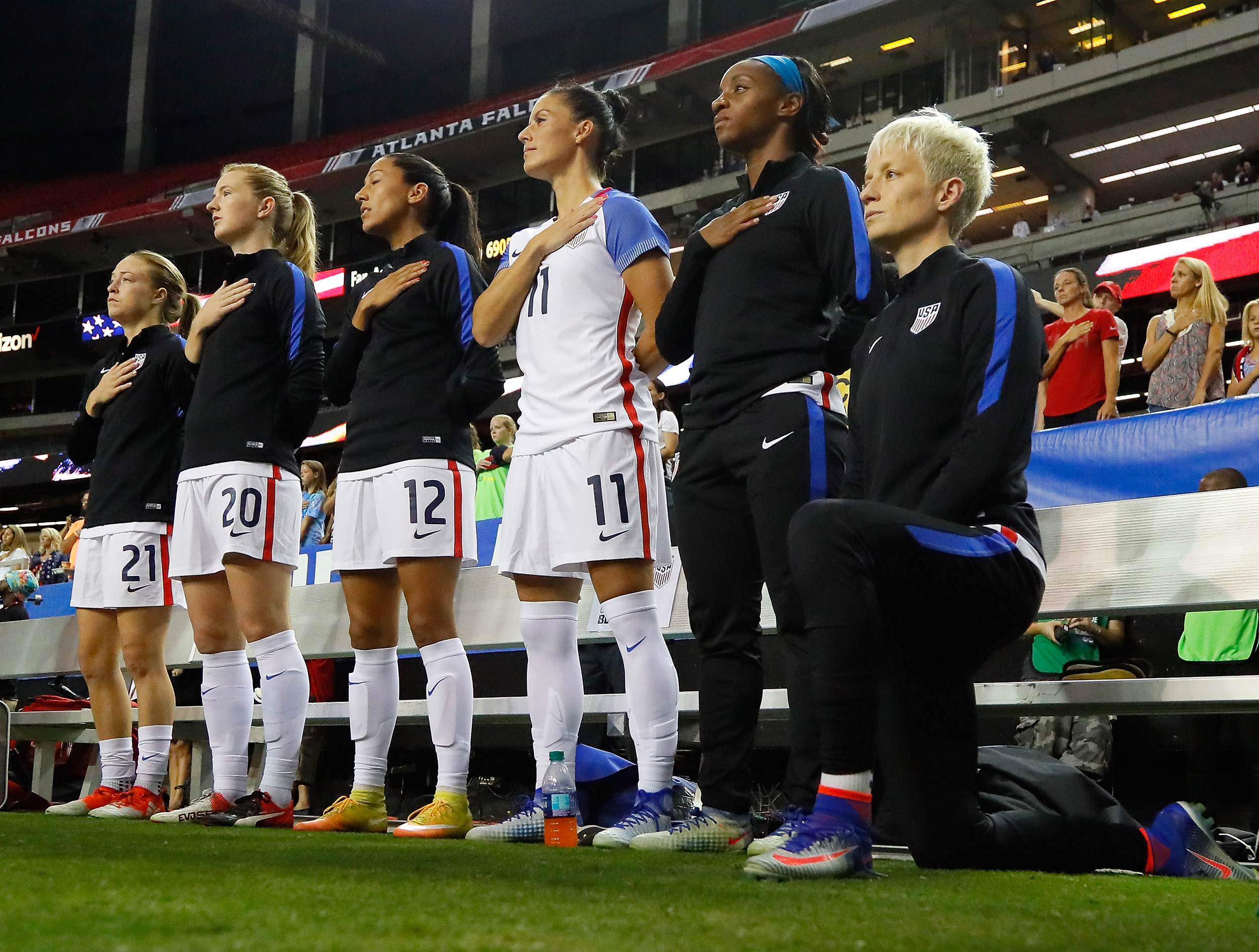 Megan Rapinoe kneels during the National Anthem prior to the match between the United States and the Netherlands at Georgia Dome in Atlanta, on September 18, 2016.