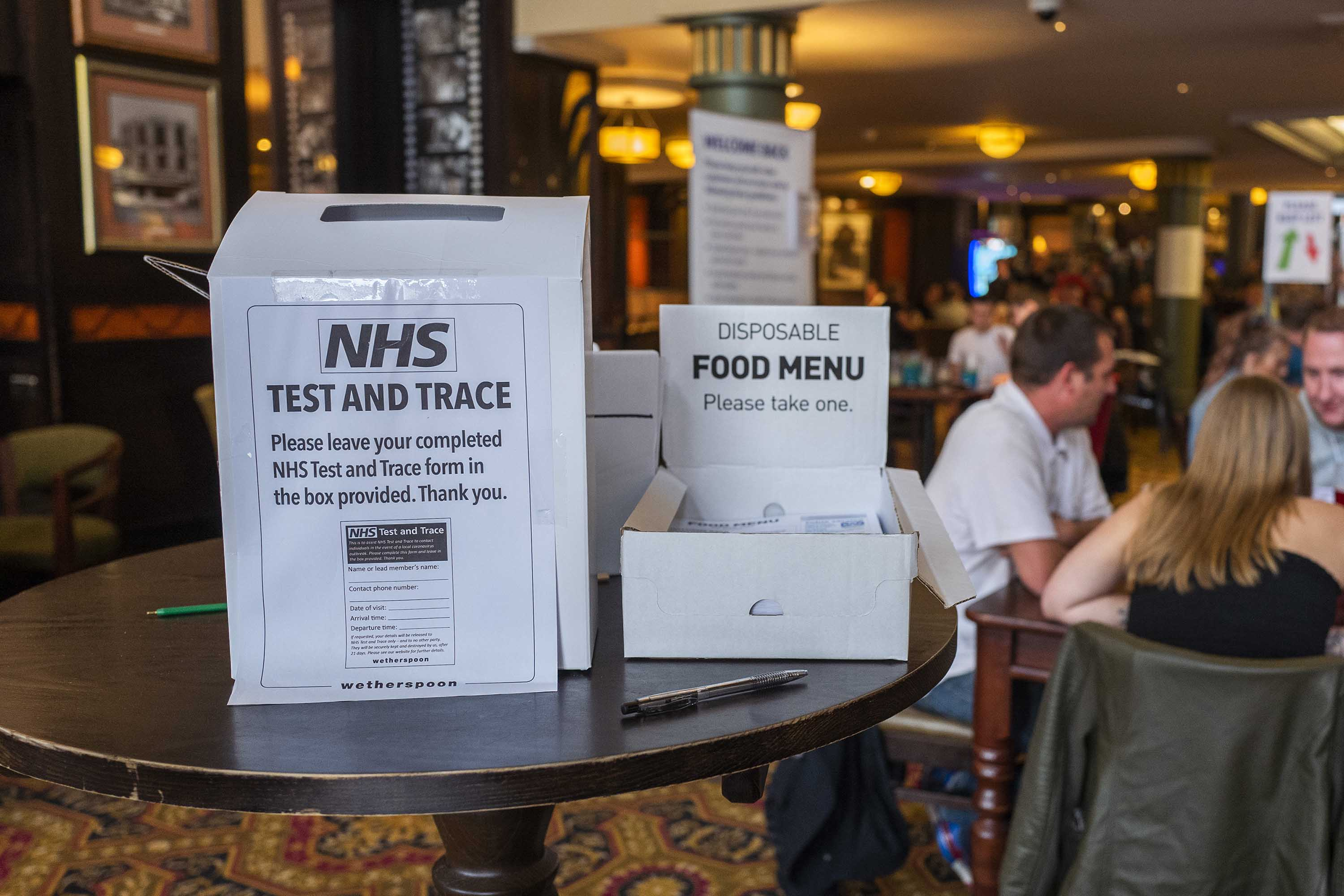 Britain's National Health Service Test and Trace form is displayed at the entrance of a pub in Rochdale, England, on July 4.