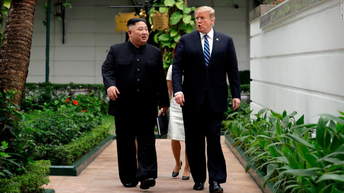 Kim and Trump go for a brief outdoor stroll at the beginning of their second day of meetings in Hanoi.