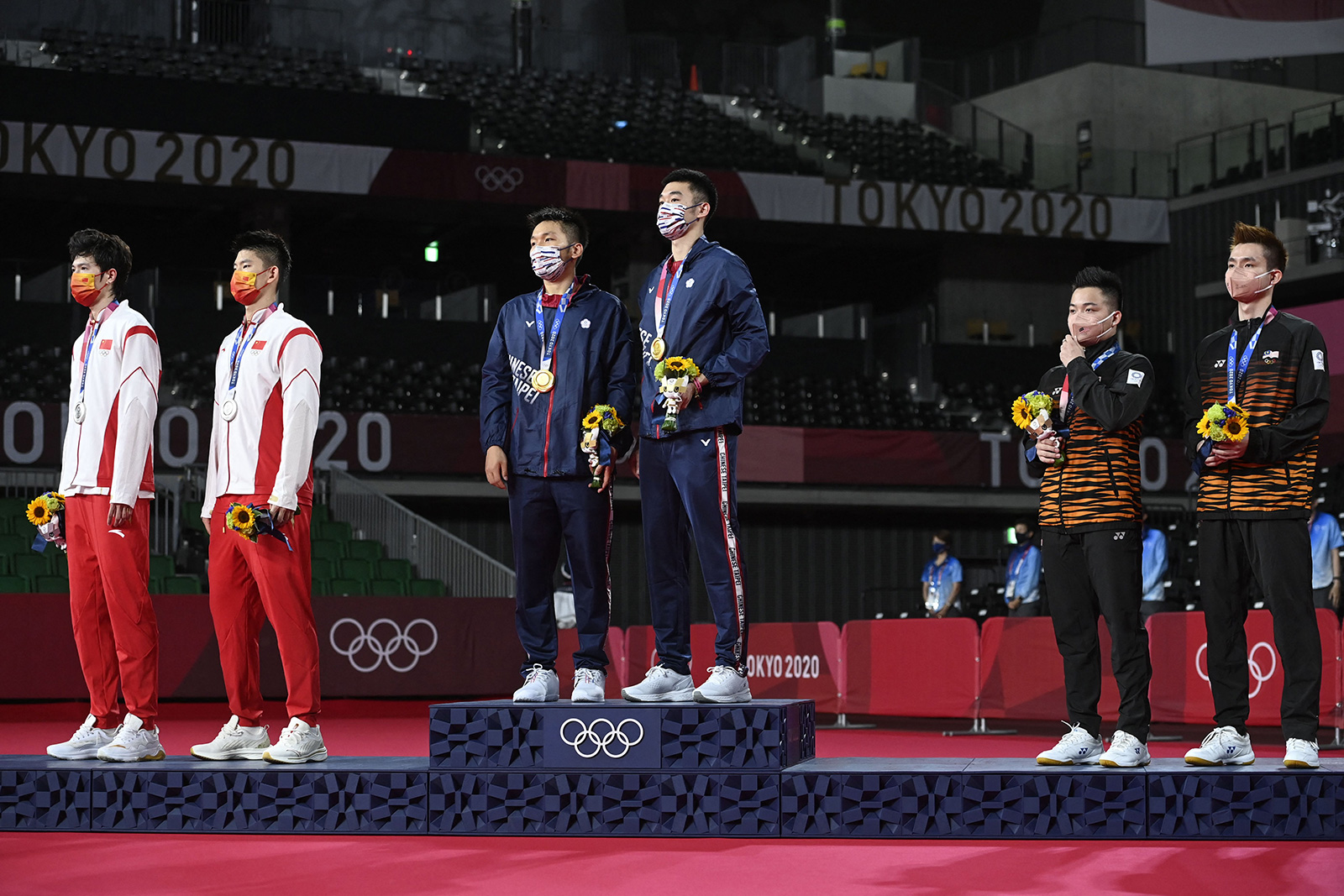 Taiwan's Lee Yang and Wang Chi-lin pose with their men's doubles badminton gold medals next to China's Liu Yuchen and Li Junhui with their silver medals, and Malaysia's Aaron Chia and Soh Wooi Yik with their bronze medals at a ceremony on Saturday.