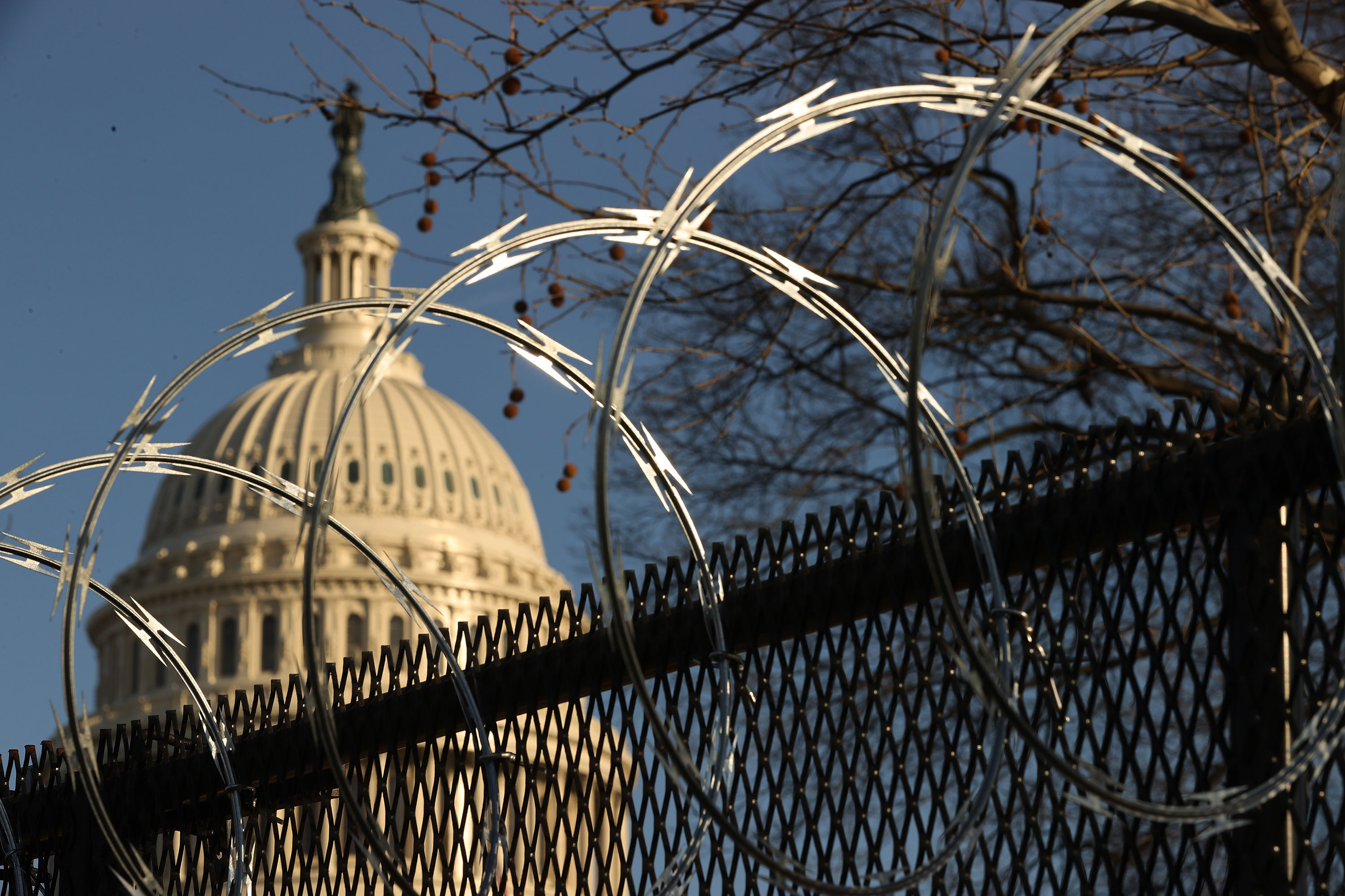 Concertina razor wire tops the 8-foot fence that surrounds the Capitol in Washington on January 14.