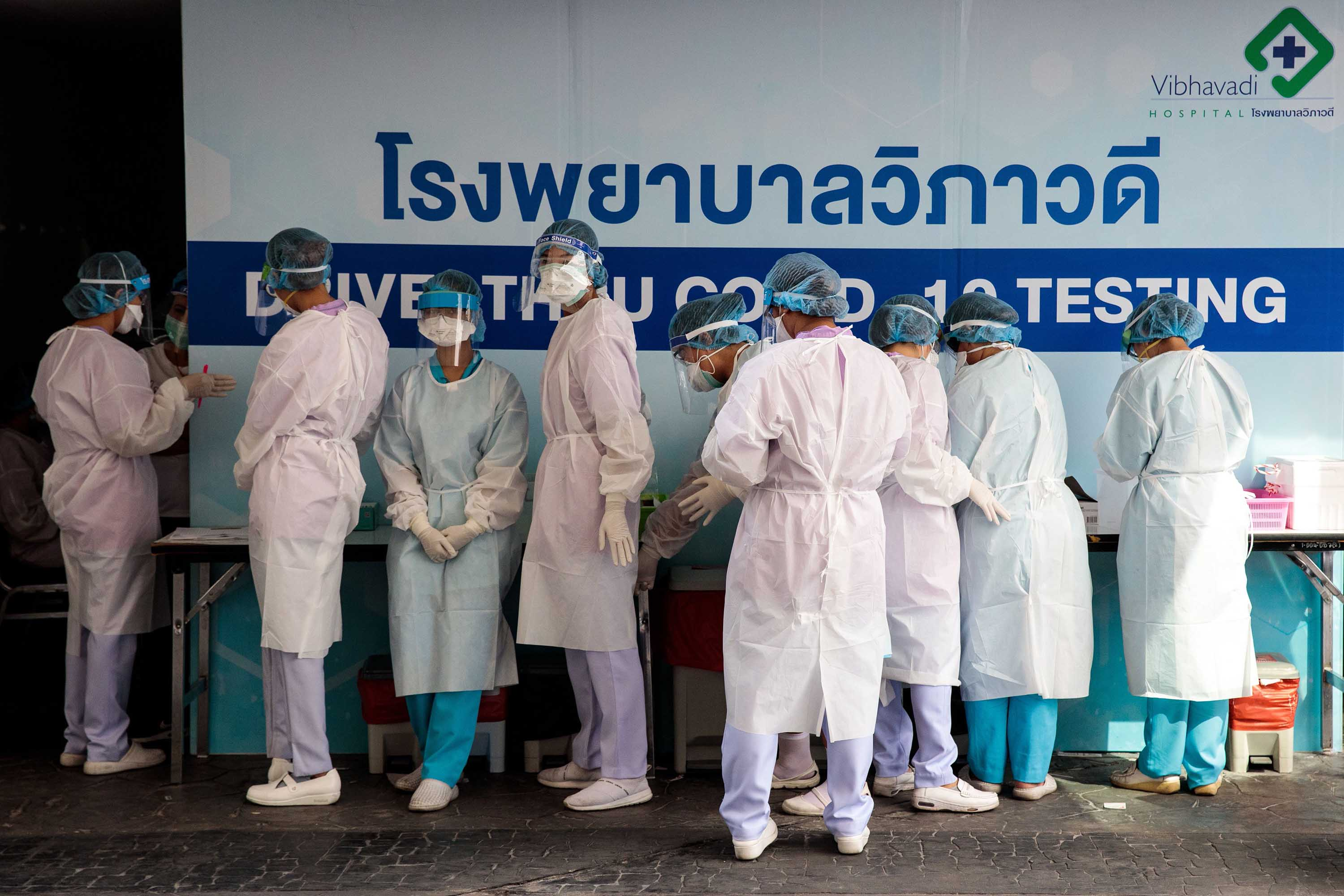 Medical staff prepare to test people for coronavirus at a drive-through testing center in Bangkok on March 25.