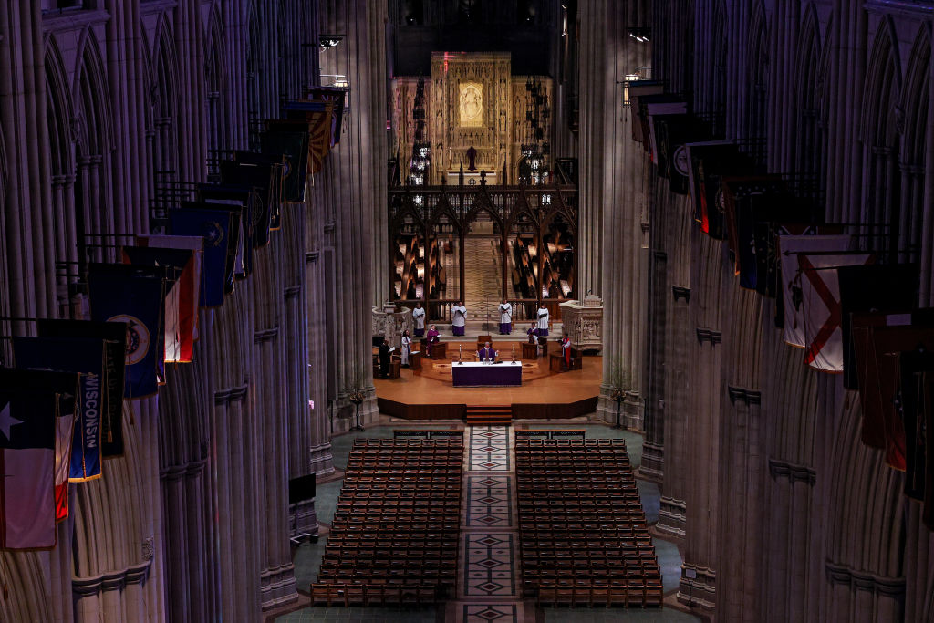 The Very Rev. Dean Randy Hollerith holds Sunday Mass as it is live-webcast to its parishioners due to coronavirus at an empty Washington National Cathedral on March 22, in Washington, DC.