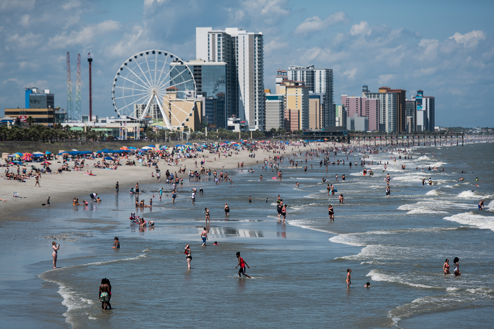 People wade in the surf in Myrtle Beach, South Carolina, on May 23.
