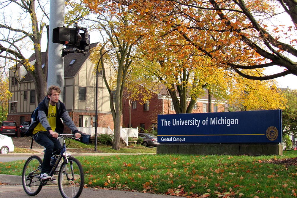 A cyclist rides through University of Michigan's central campus on October 25, 2017.