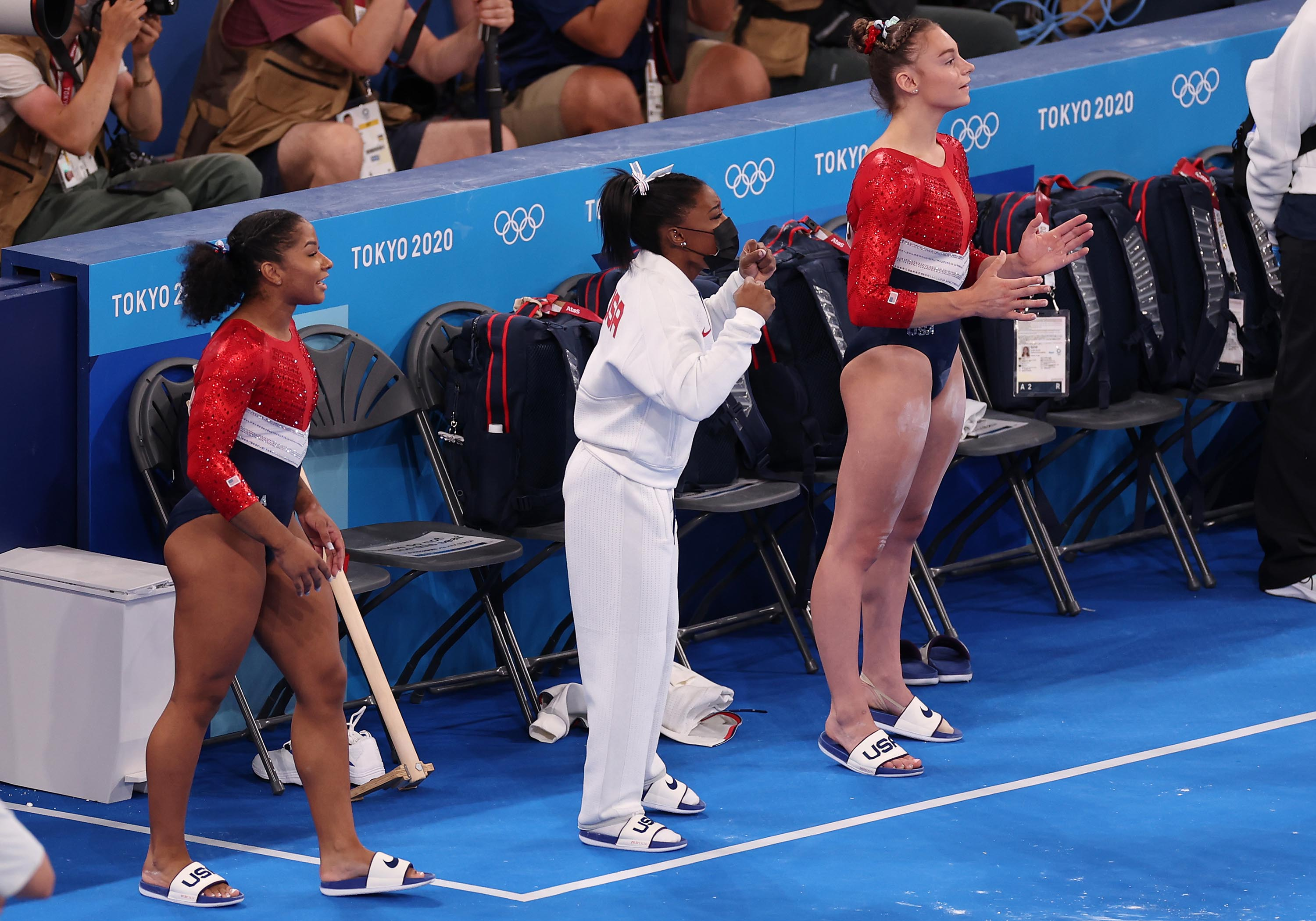 From left: Jordan Chiles, Simone Biles and Grace McCallum cheer on Sunisa Lee of Team United States as she competes on uneven bars on Tuesday.