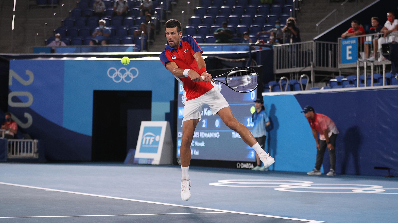 Serbia's Novak Djokovic plays a backhand during his quarterfinal match against Japan's Kei Nishikori on July 29.
