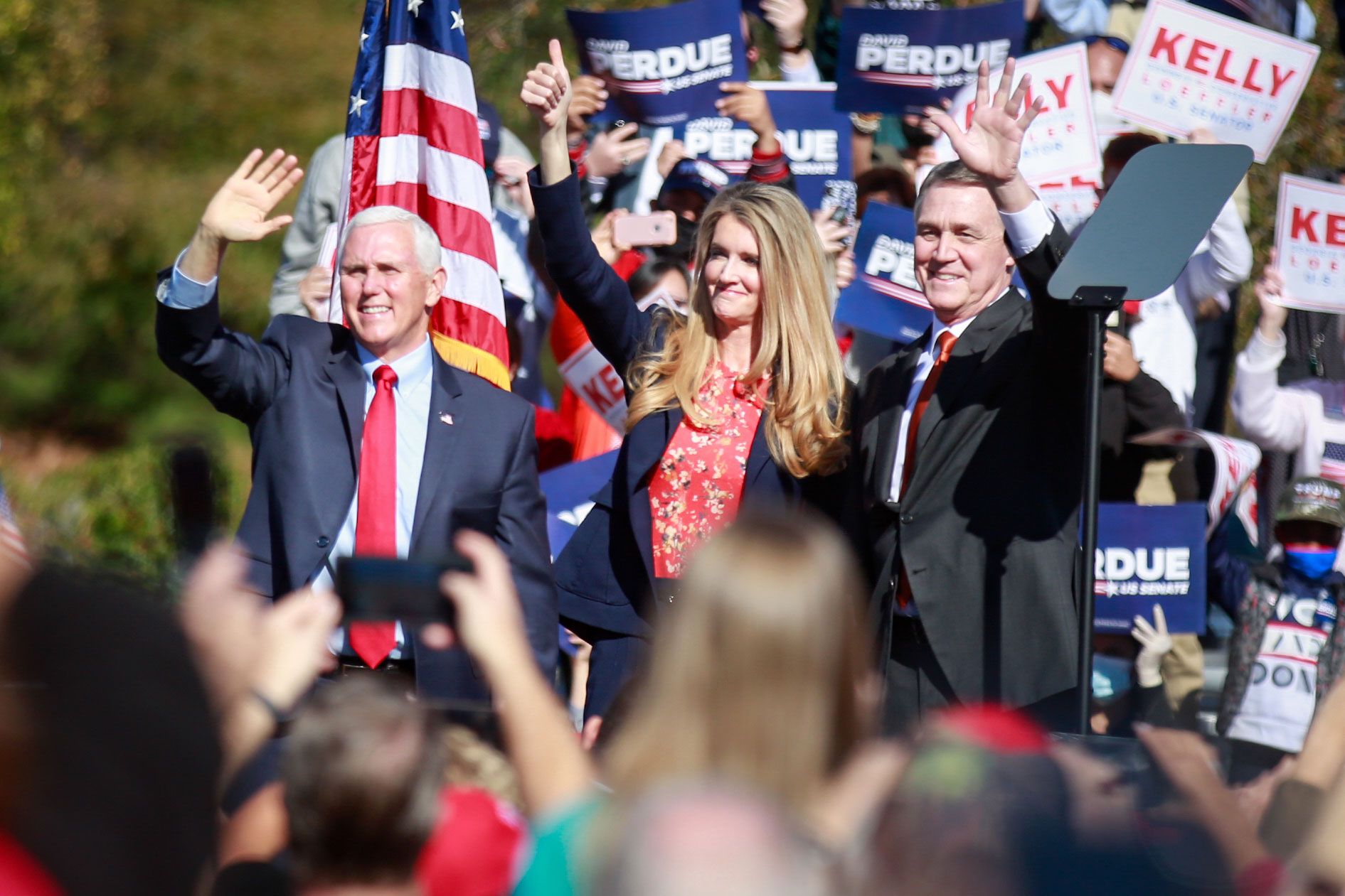 Vice President Mike Pence, Sen. Kelly Loeffler and Sen. David Perdue wave to supporters at a campaign rally in Canton, Georgia, on November 20.