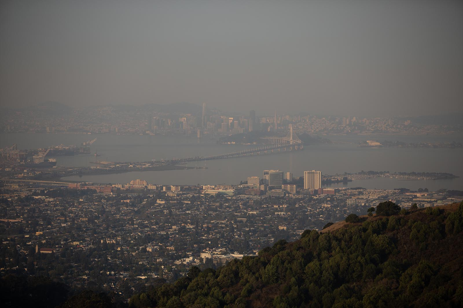 Smoke from wildfires fills the air over the San Francisco and Oakland skylines as seen from Berkeley, California, on Monday, September 28.