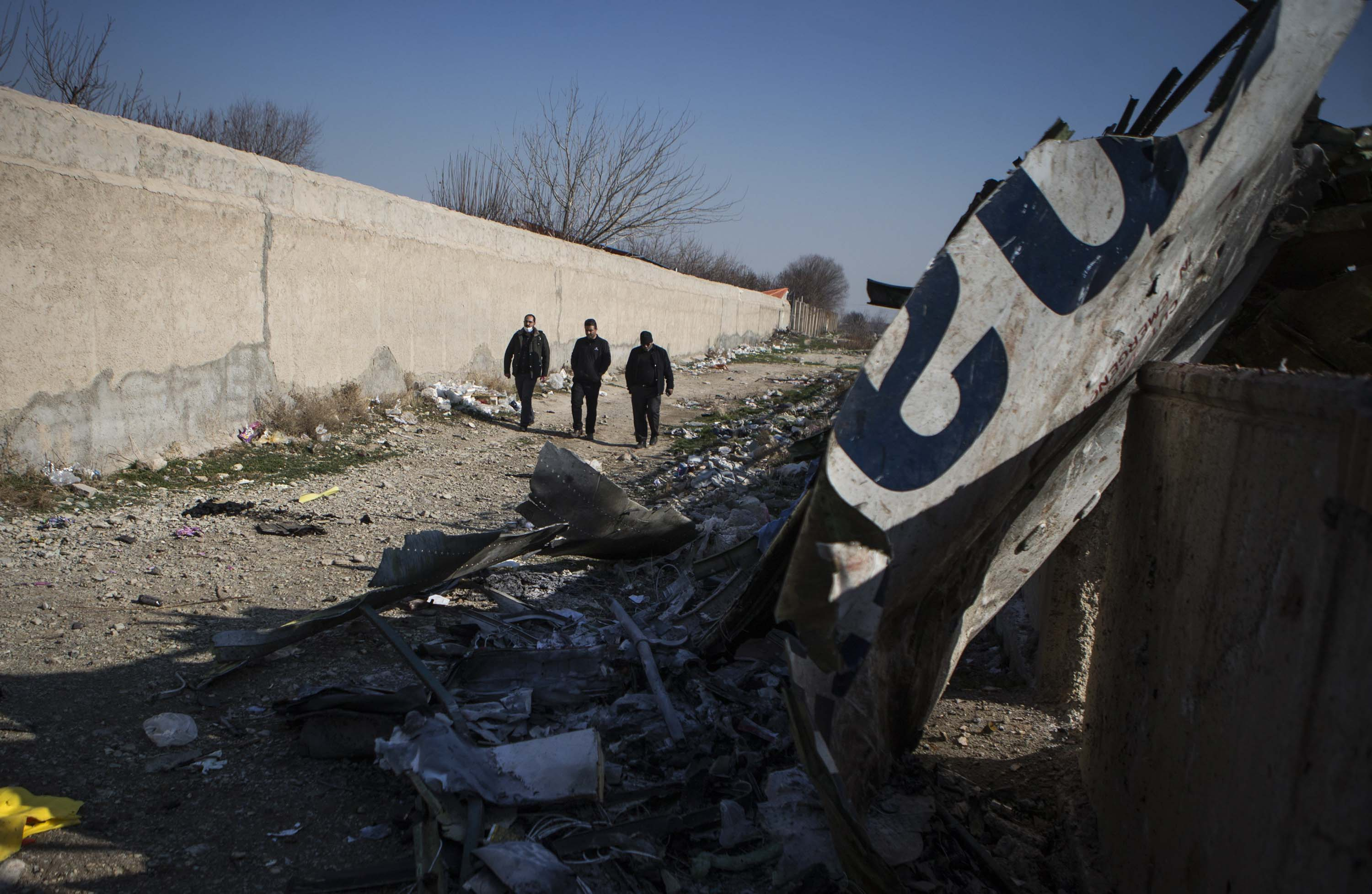 Parts of the Ukrainian International Airlines plane are seen strewn at the site of the crash in Iran on Wednesday.