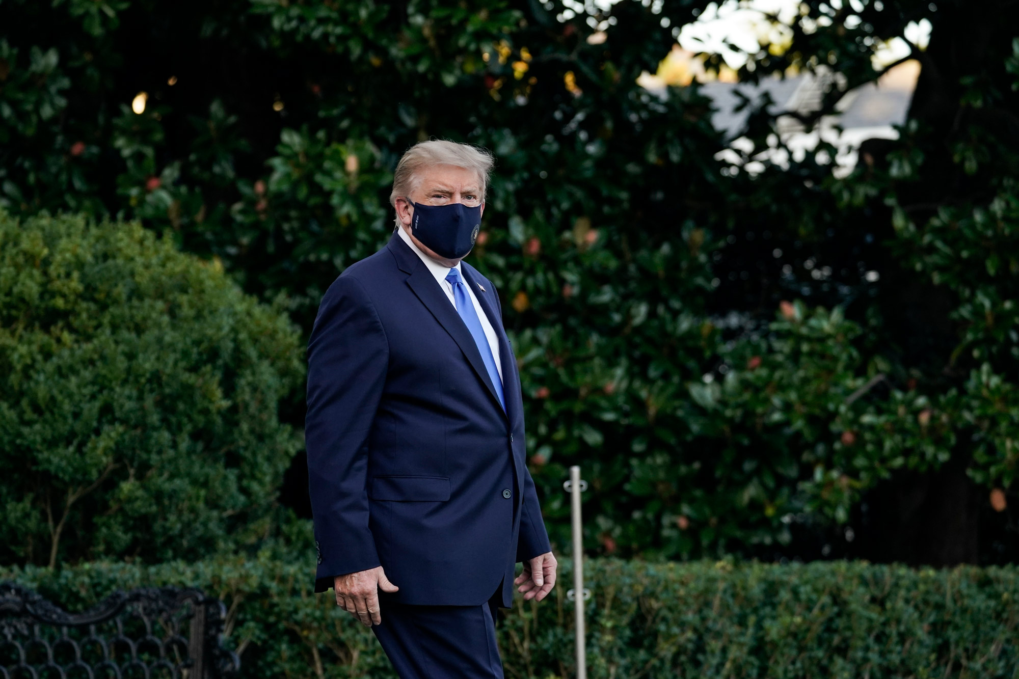 President Donald Trump leaves the White House for Walter Reed National Military Medical Center on the South Lawn of the White House on October 2 in Washington, DC.