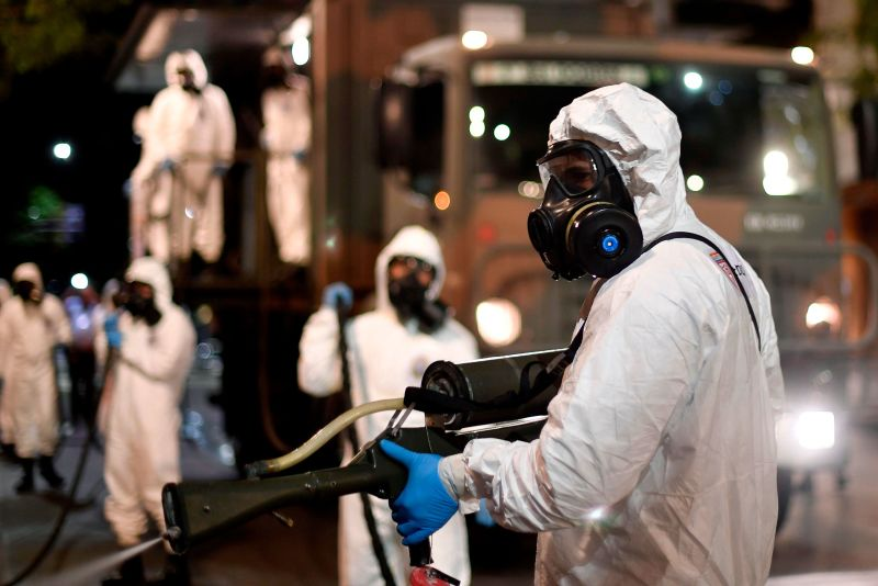 Soldiers spray disinfectant at a market in Belo Horizonte, Brazil, on August 18.