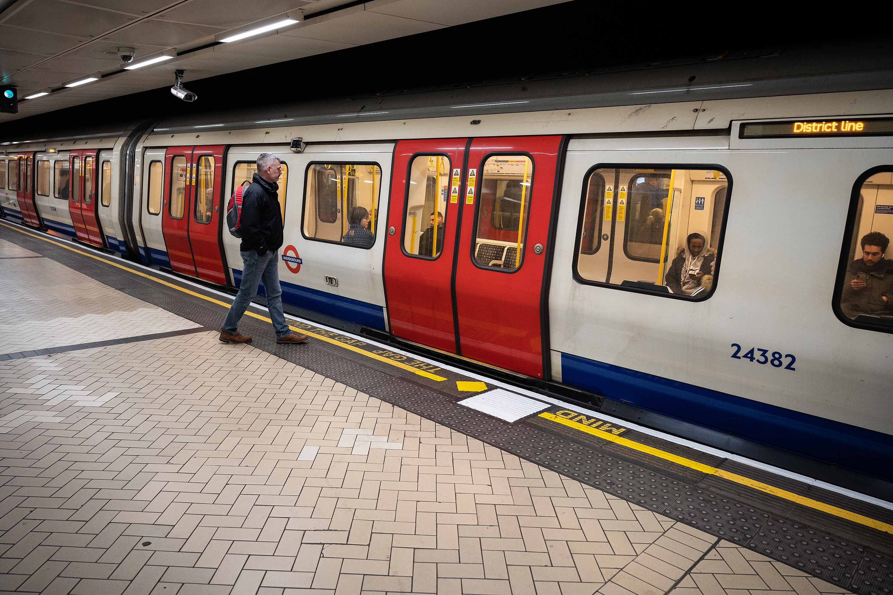 A commuter boards an underground train during rush-hour in London, England, on March 18.