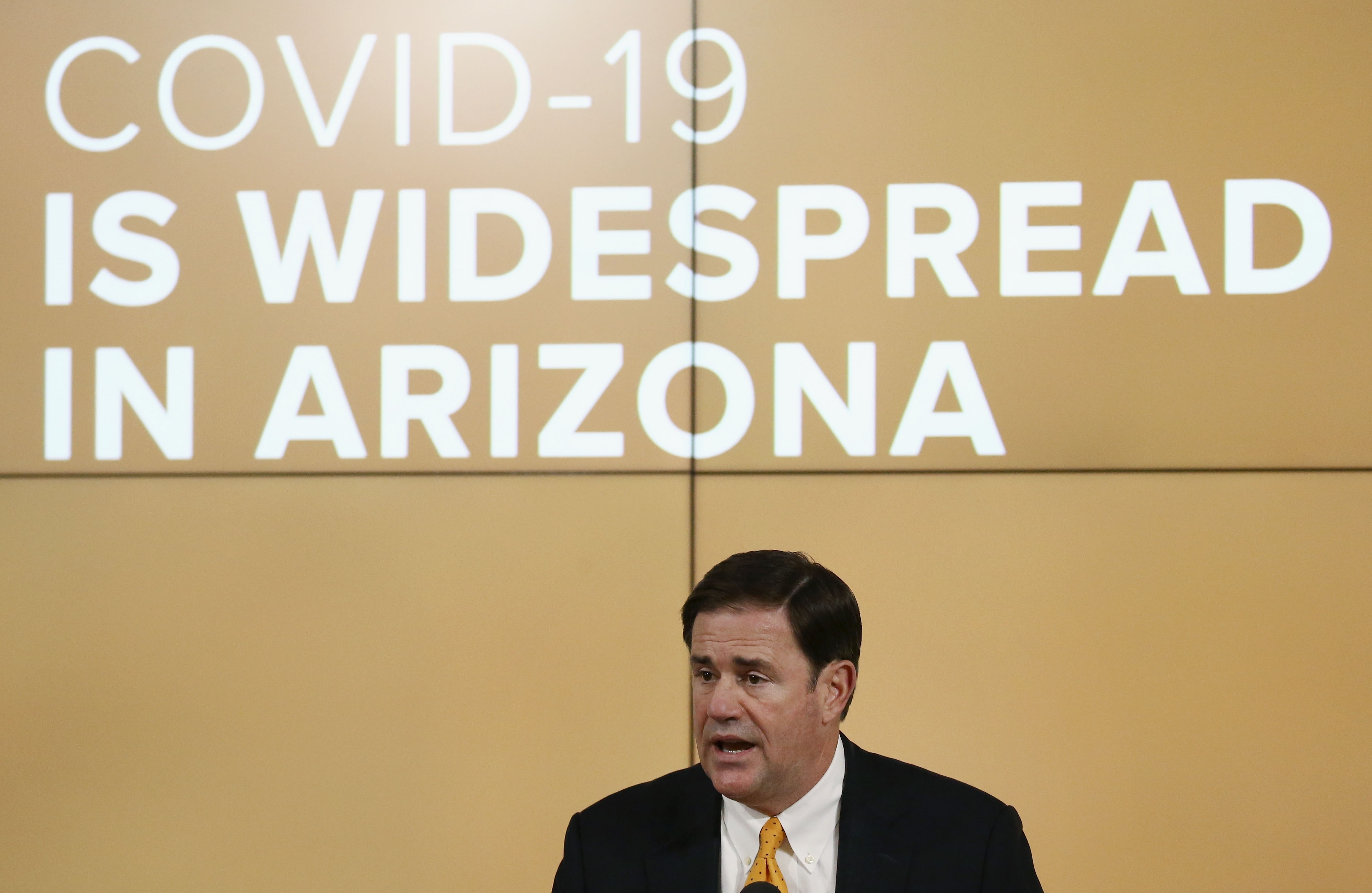 Arizona Gov. Doug Ducey speaks at a news conference in Phoenix on June 25.