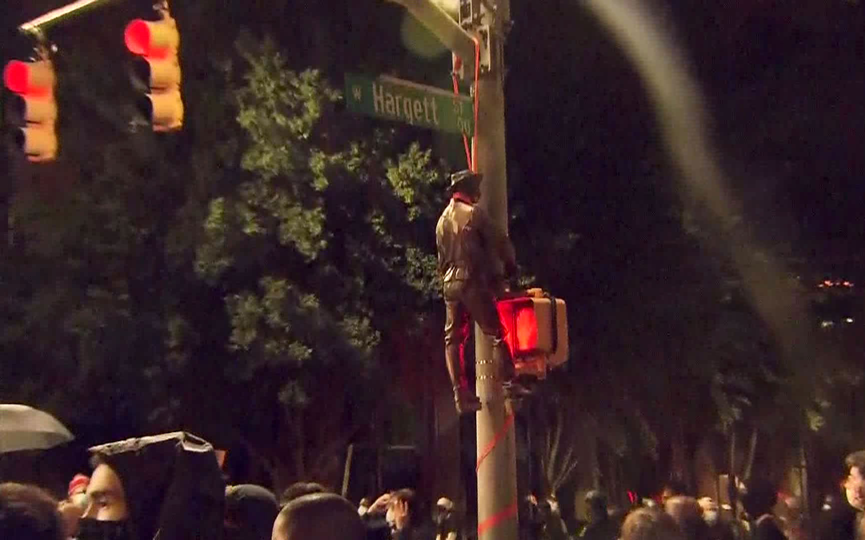 Protesters hang a Confederate statue from a light post on Friday, June 19 in Raleigh, North Carolina.