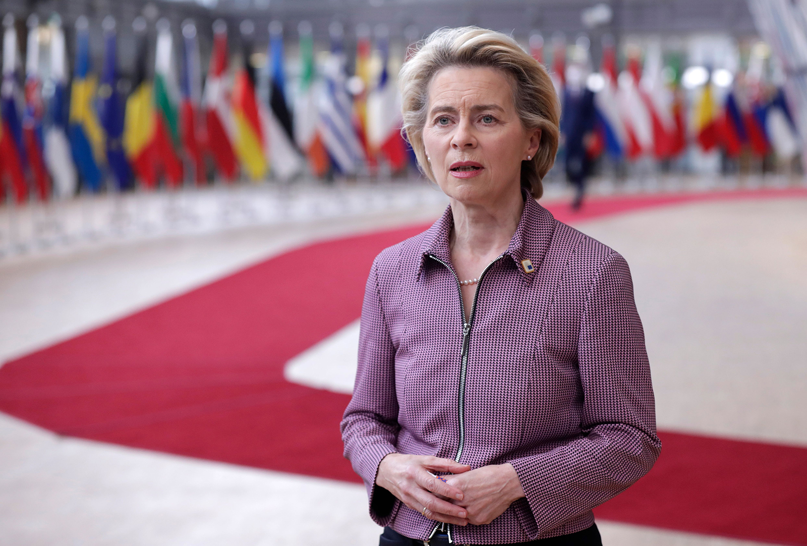 President of the European Commission Ursula von der Leyen speaks to the press as she arrives prior to an EU summit in Brussels, on October 15.
