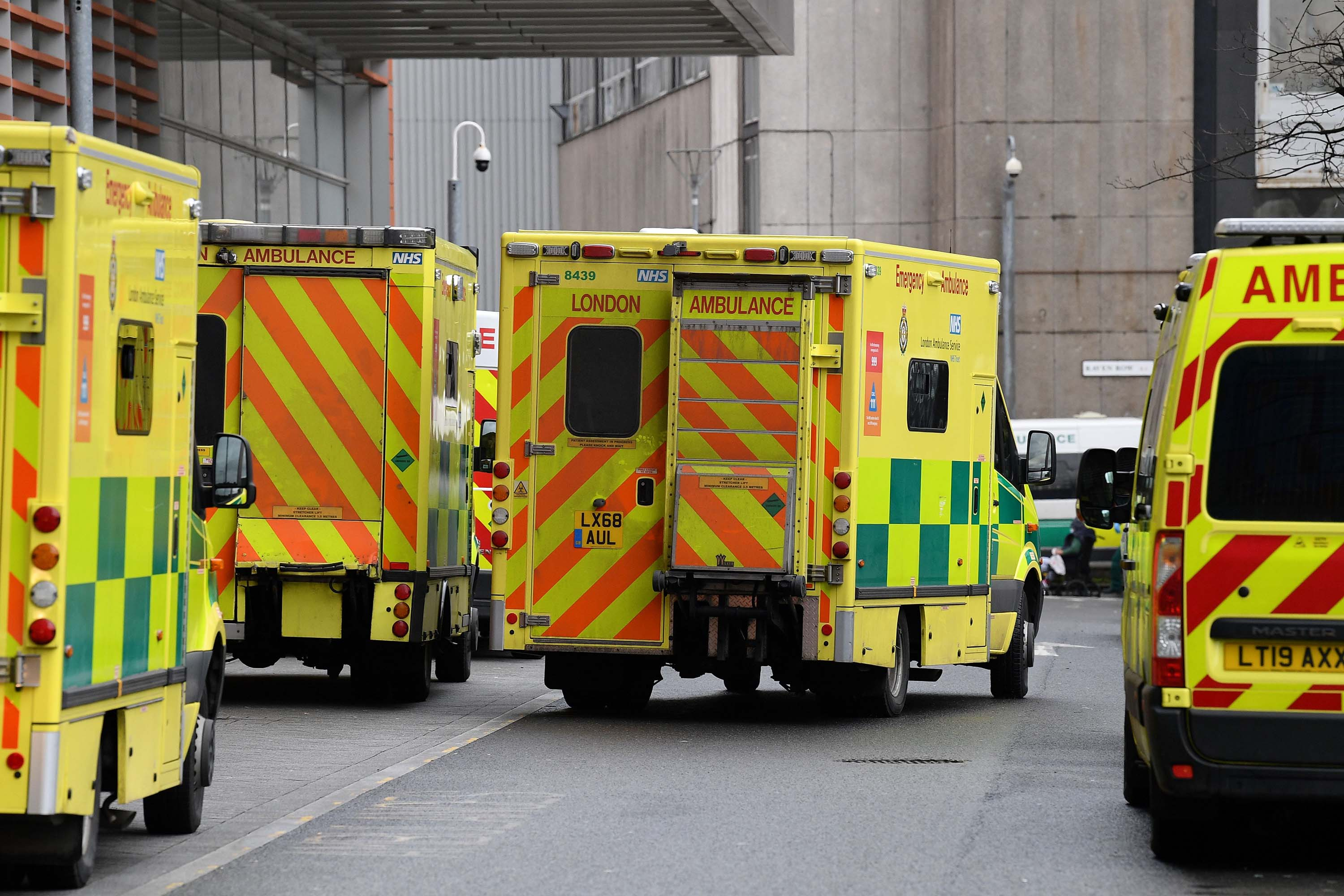 Ambulances are seen parked outside the Royal London Hospital in London, on January 28.