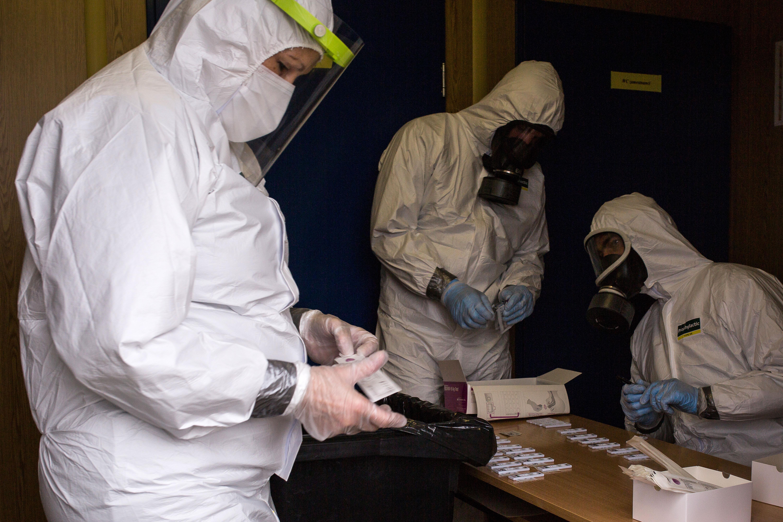 Health workers evaluate Covid-19 antigen tests on November 7 in Prešov, Slovakia.
