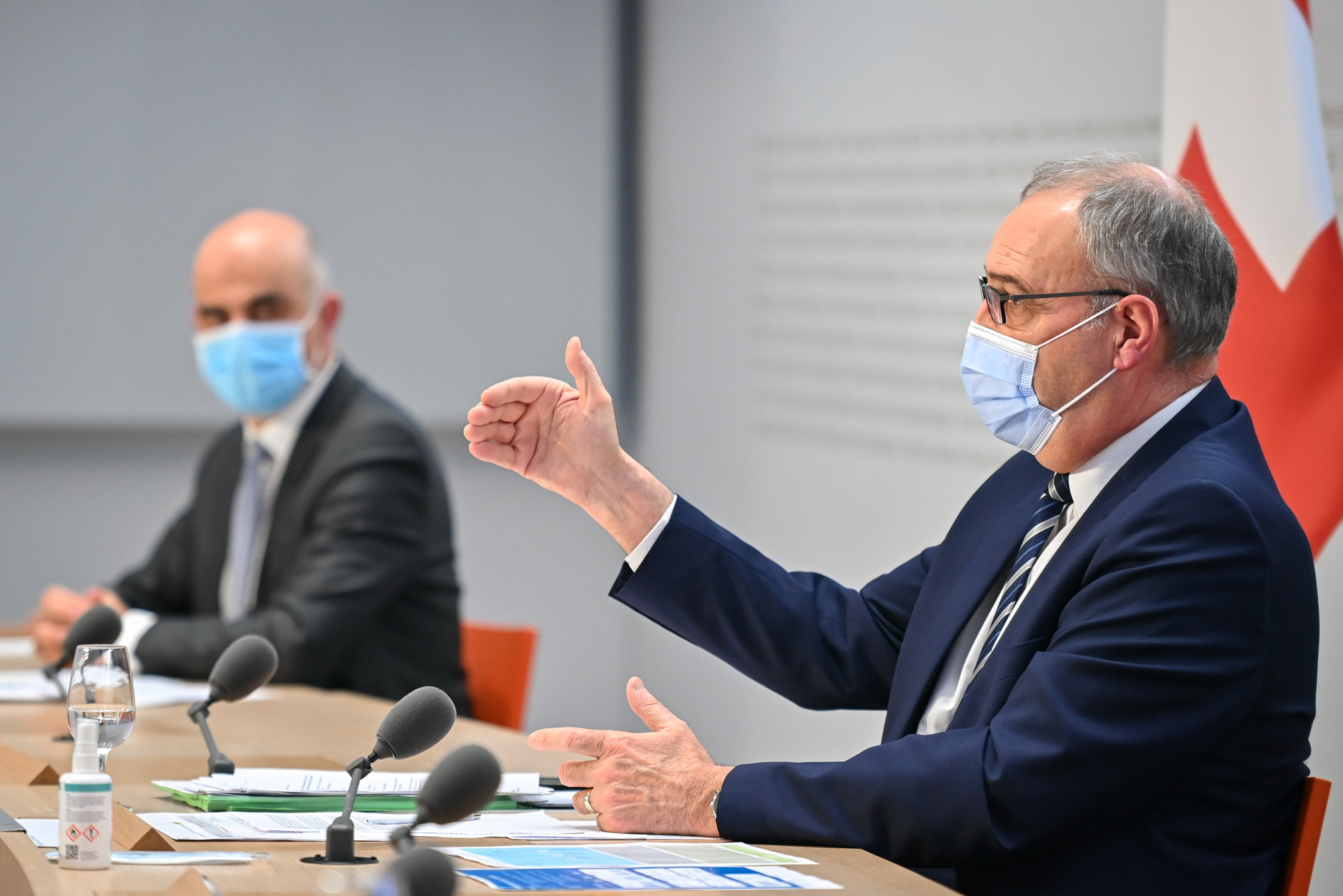 Swiss President Guy Parmelin, right, speaks next to Swiss Interior and Health Minister Alain Berset during a press conference on February 24 in Bern, Switzerland.