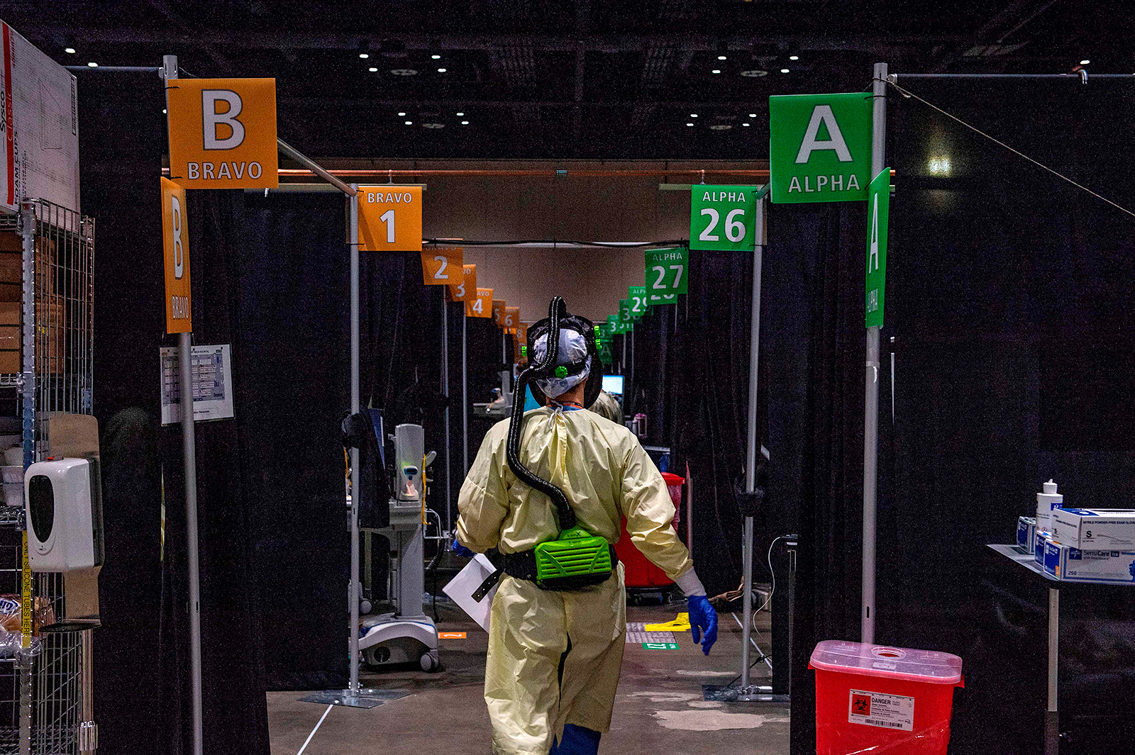 Inside the hot zone, medical staff monitor and treat sick patients infected with the Covid-19 virus at the UMASS Memorial DCU Center Field Hospital in Worcester, Massachusetts, on January 13
