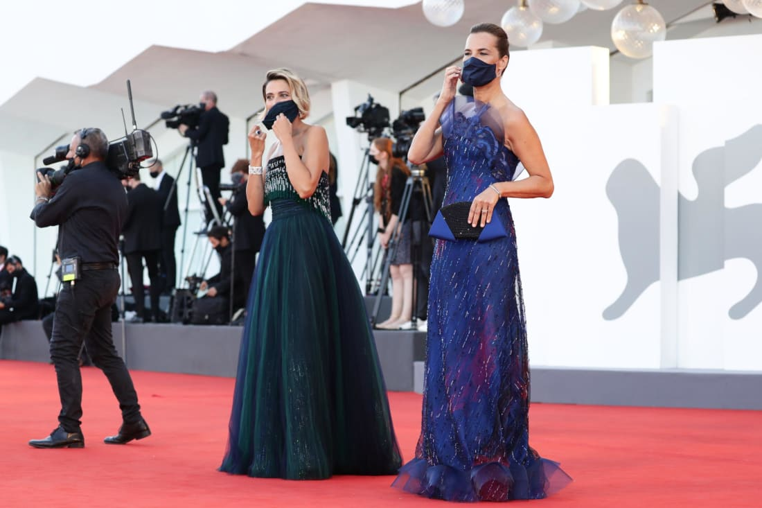 Actors Anna Foglietta and Roberta Armani arrive for the opening ceremony in cloth masks matching their dark green and vivid blue looks.