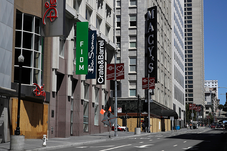 In this May 27, file photo, closed businesses are seen in downtown San Francisco.