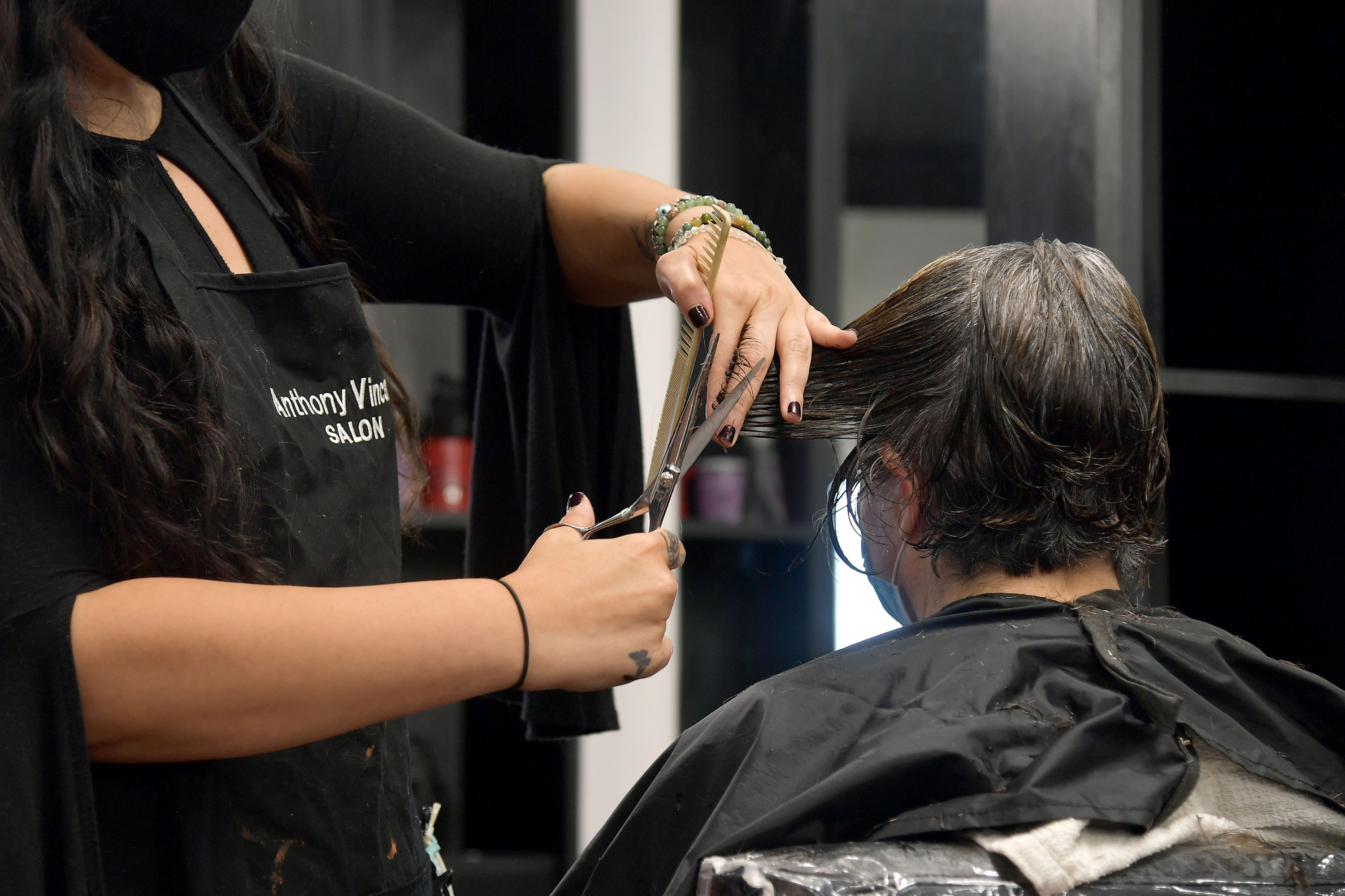 A customer gets her hair cut in East Windsor, New Jersey, on June 22.
