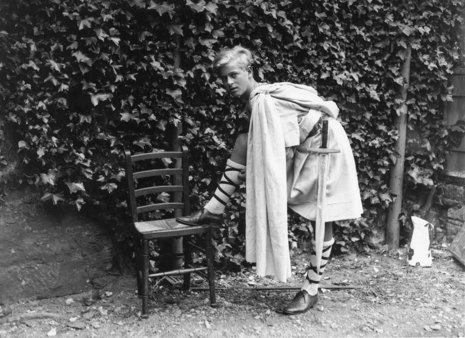 """Prince Philip is dressed for a production of """"Macbeth"""" while attending school in Scotland in July 1935."""