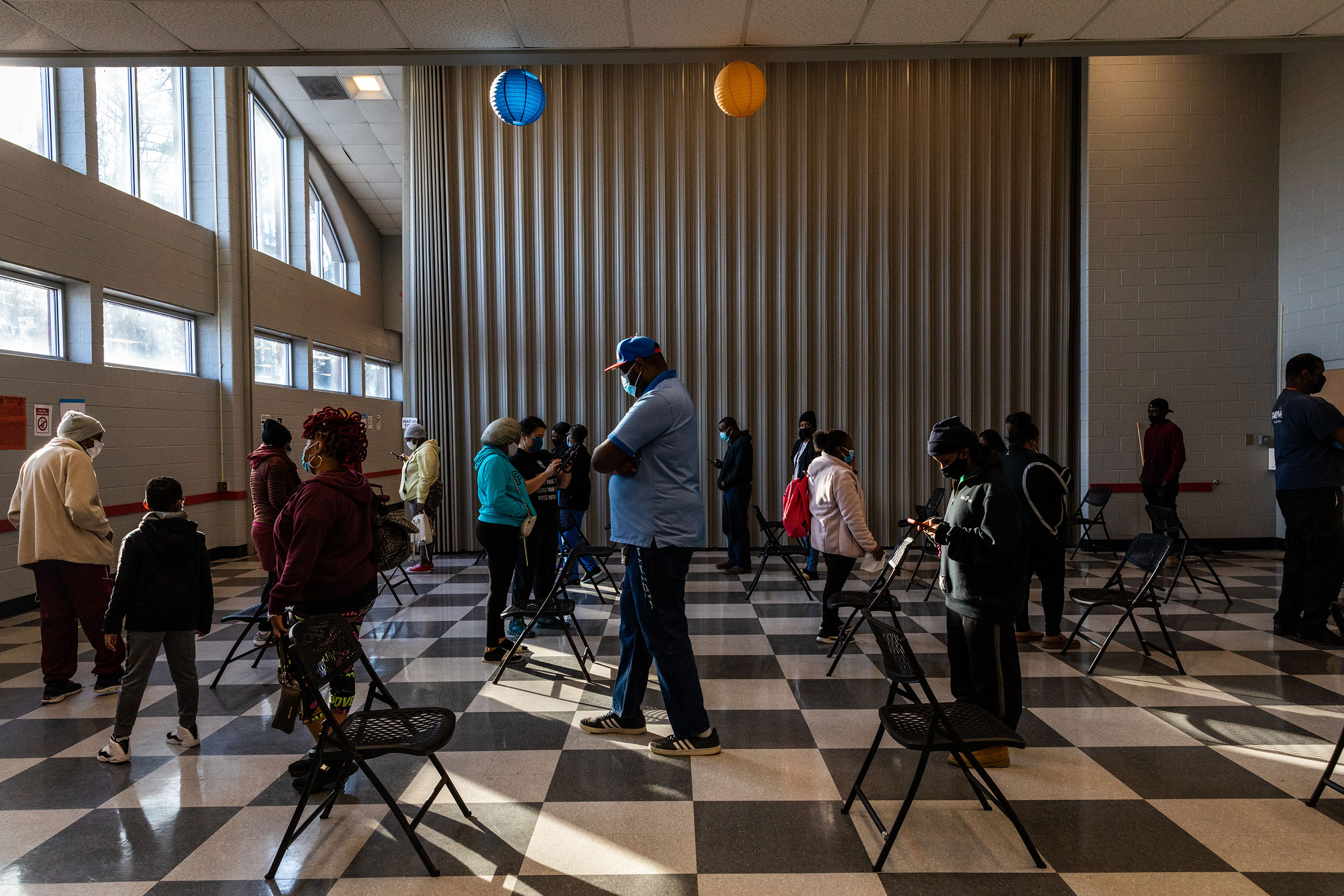 Voters stand in line to cast their ballots in Atlanta on Tuesday, January 5.