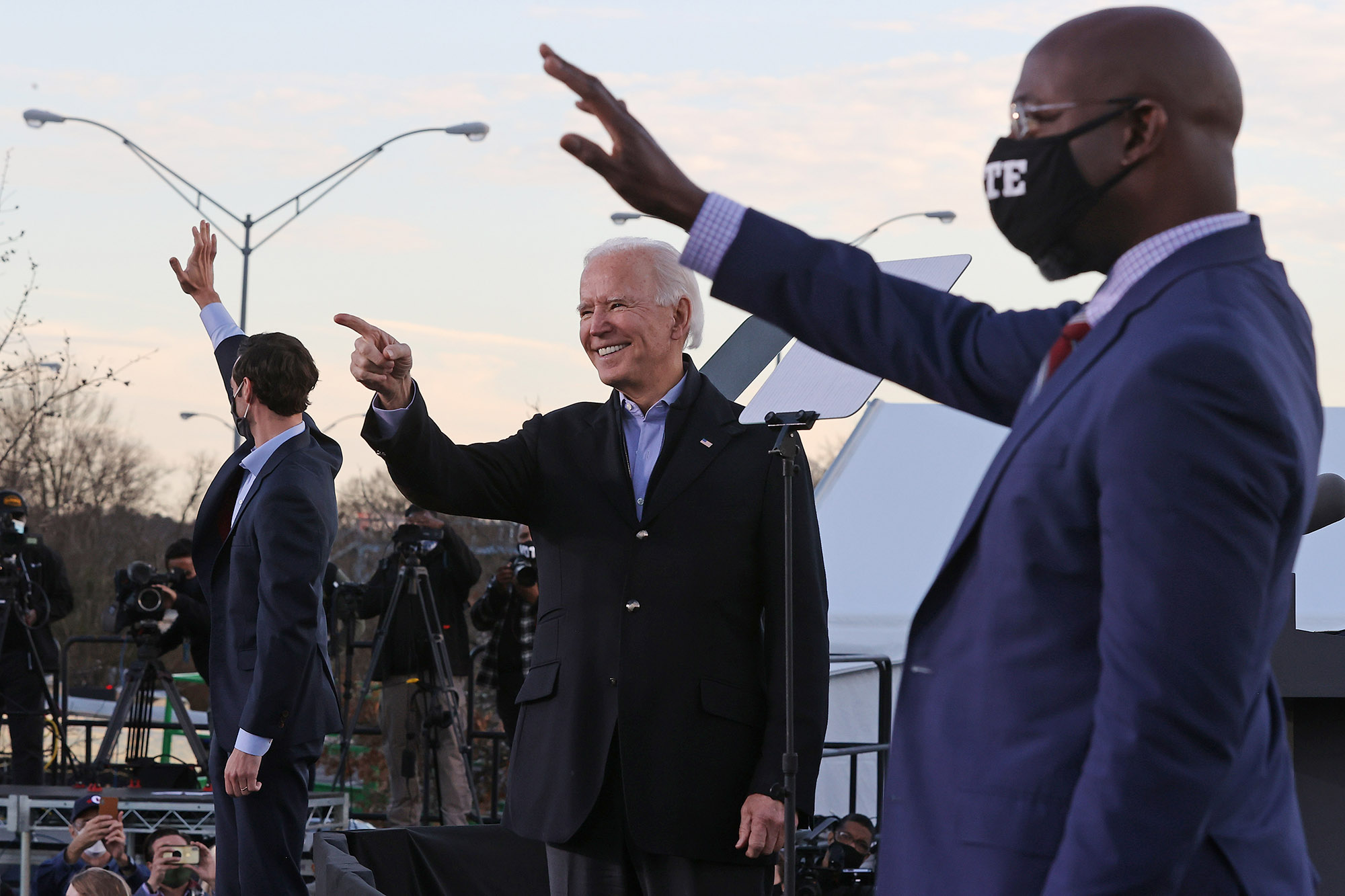 President-elect Joe Biden rallies with Democratic candidates for the U.S. Senate Jon Ossoff and Rev. Raphael Warnock the day before their runoff election in the parking lot of Center Parc Stadium, on January 4, in Atlanta, Georgia.