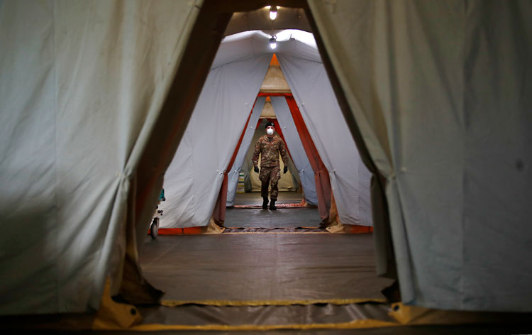An Italian soldier walks inside the field hospital built in Crema, Italy, on Tuesday, March 24.