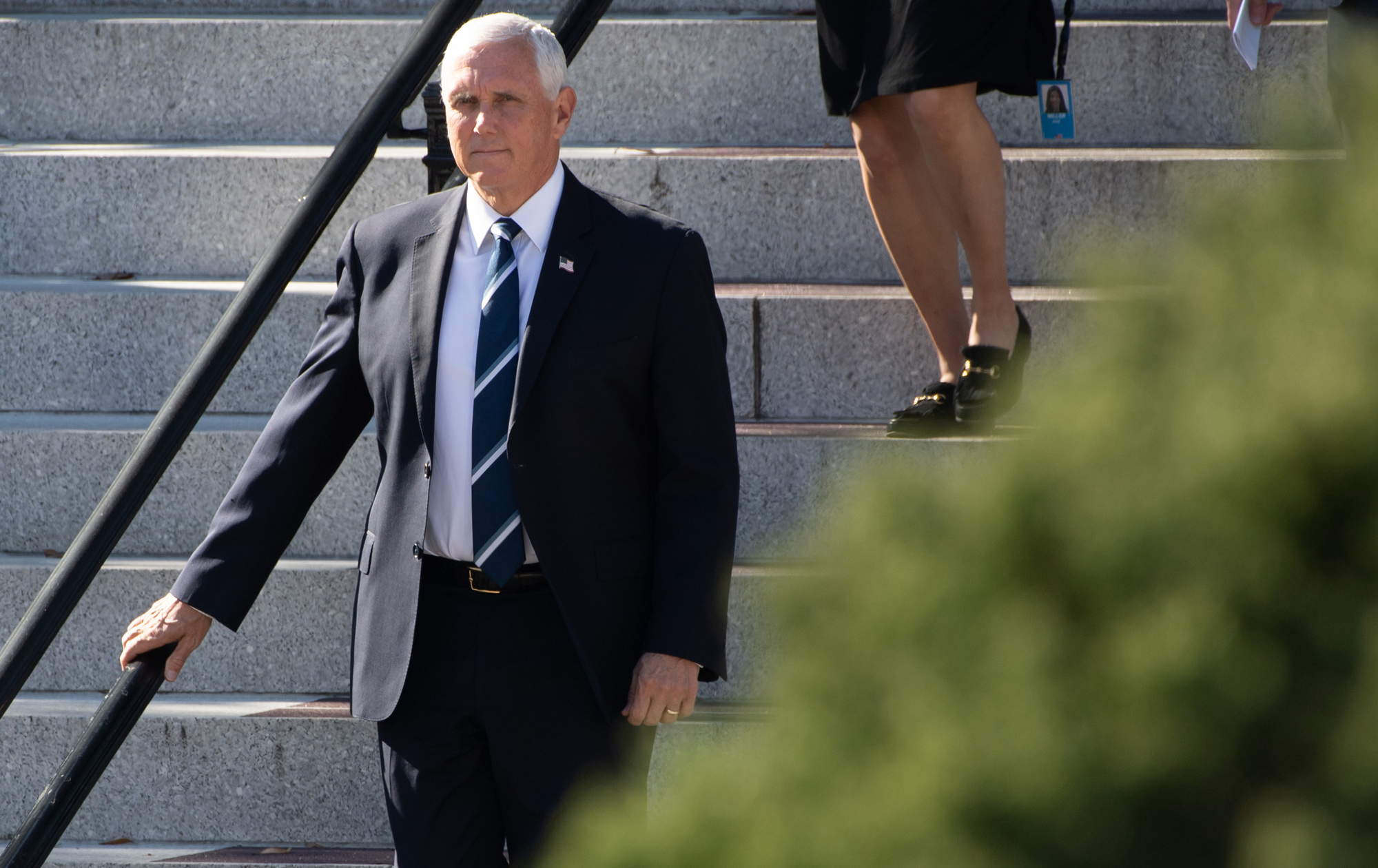 Vice President Mike Pence leaves the Eisenhower Executive Office Building in Washington, DC, on November 9.