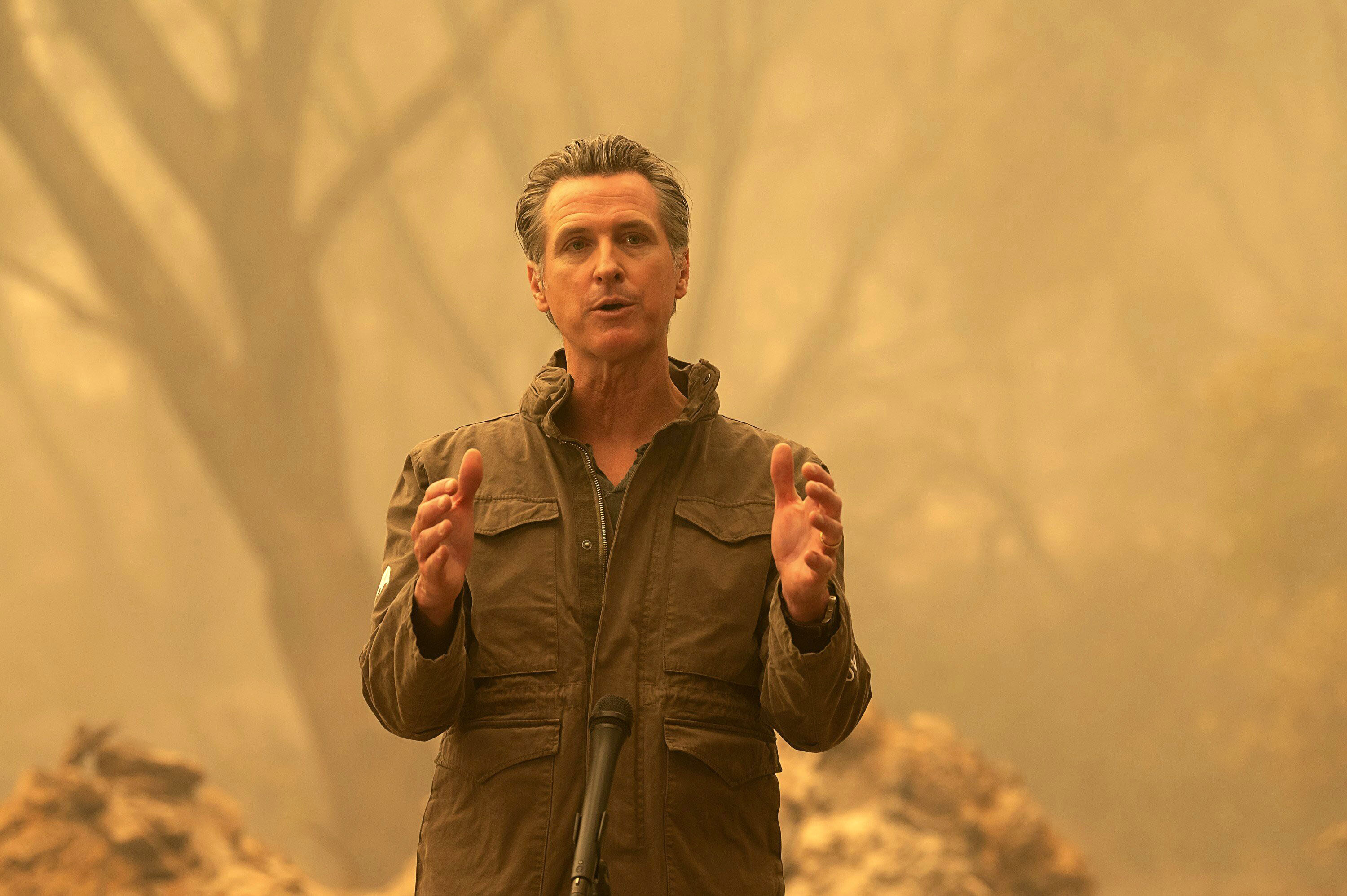 California Gov. Gavin Newsom speaks to the media outside of Oroville, California, after viewing the North Complex Fire zone on September 11.