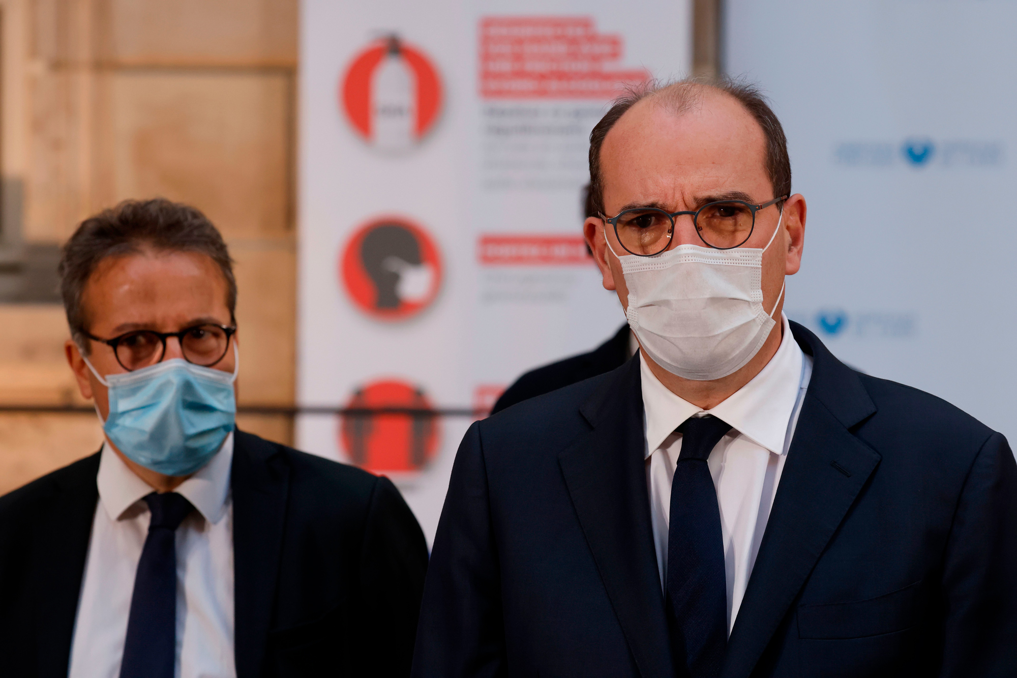 French Prime Minister Jean Castex, right, delivers a speech after a meeting at Ap-HP headquarters in Paris on October 15.