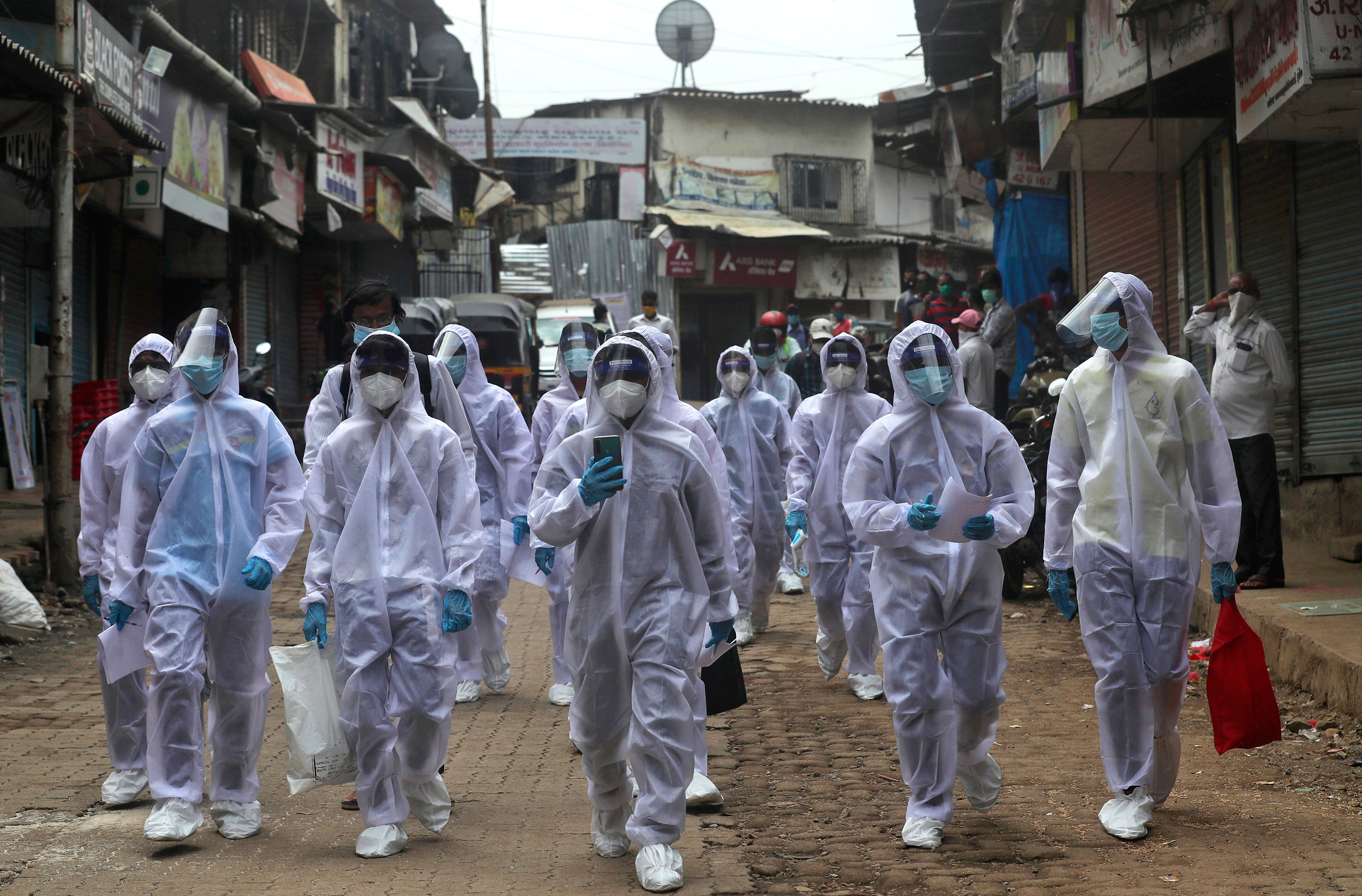 Health workers arrive to administer free medical checkups on June 28 in Mumbai, India.