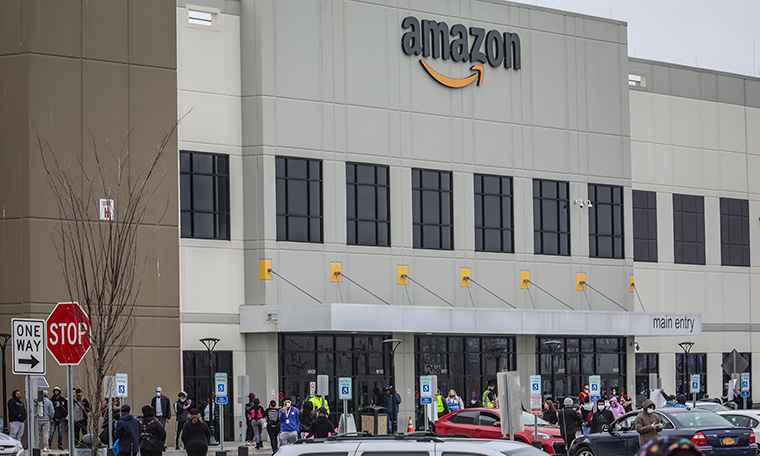 Workers at Amazon's fulfillment center in Staten Island, New York, gather outside to protest work conditions in the company's warehouse,on Monday, March 30.