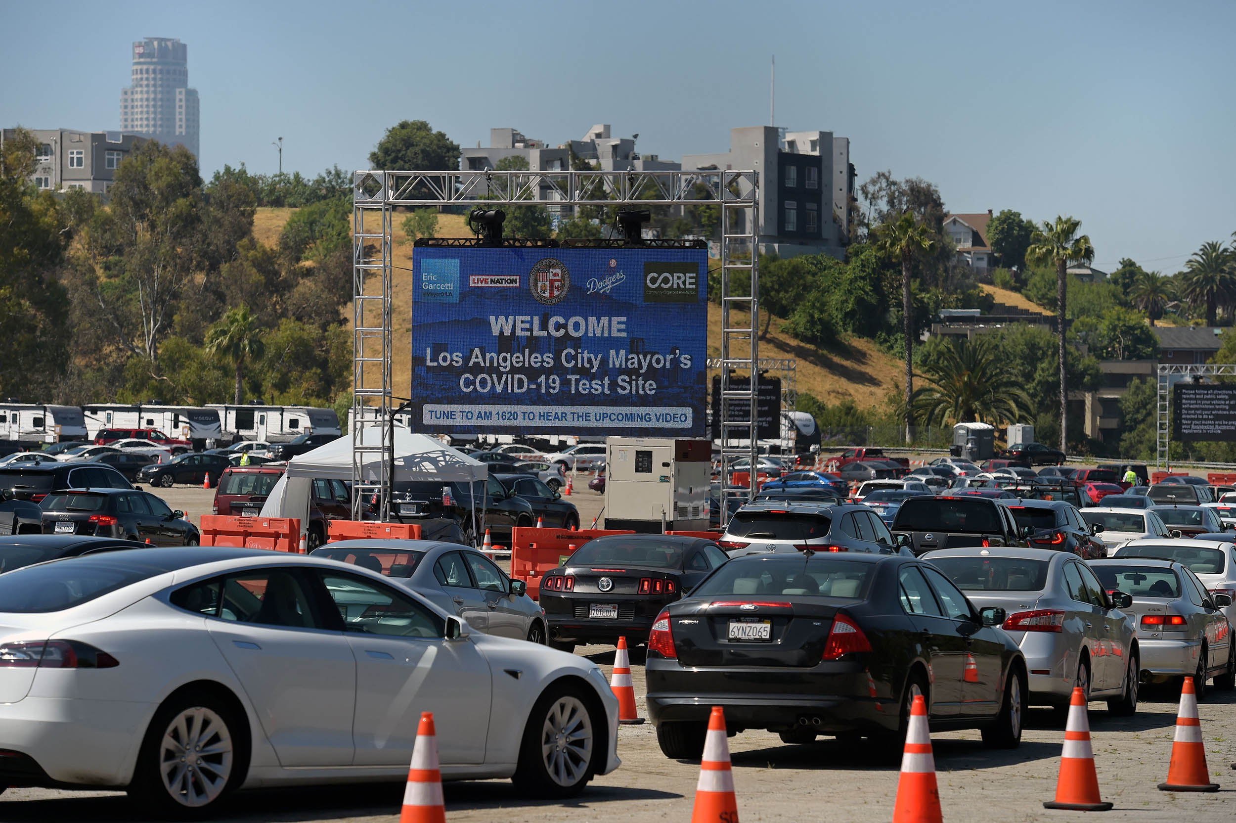 Cars line-up in a drive-through novel coronavirus testing site at the Los Angeles Dodgers stadium parking lot, in Los Angeles, on May 26.