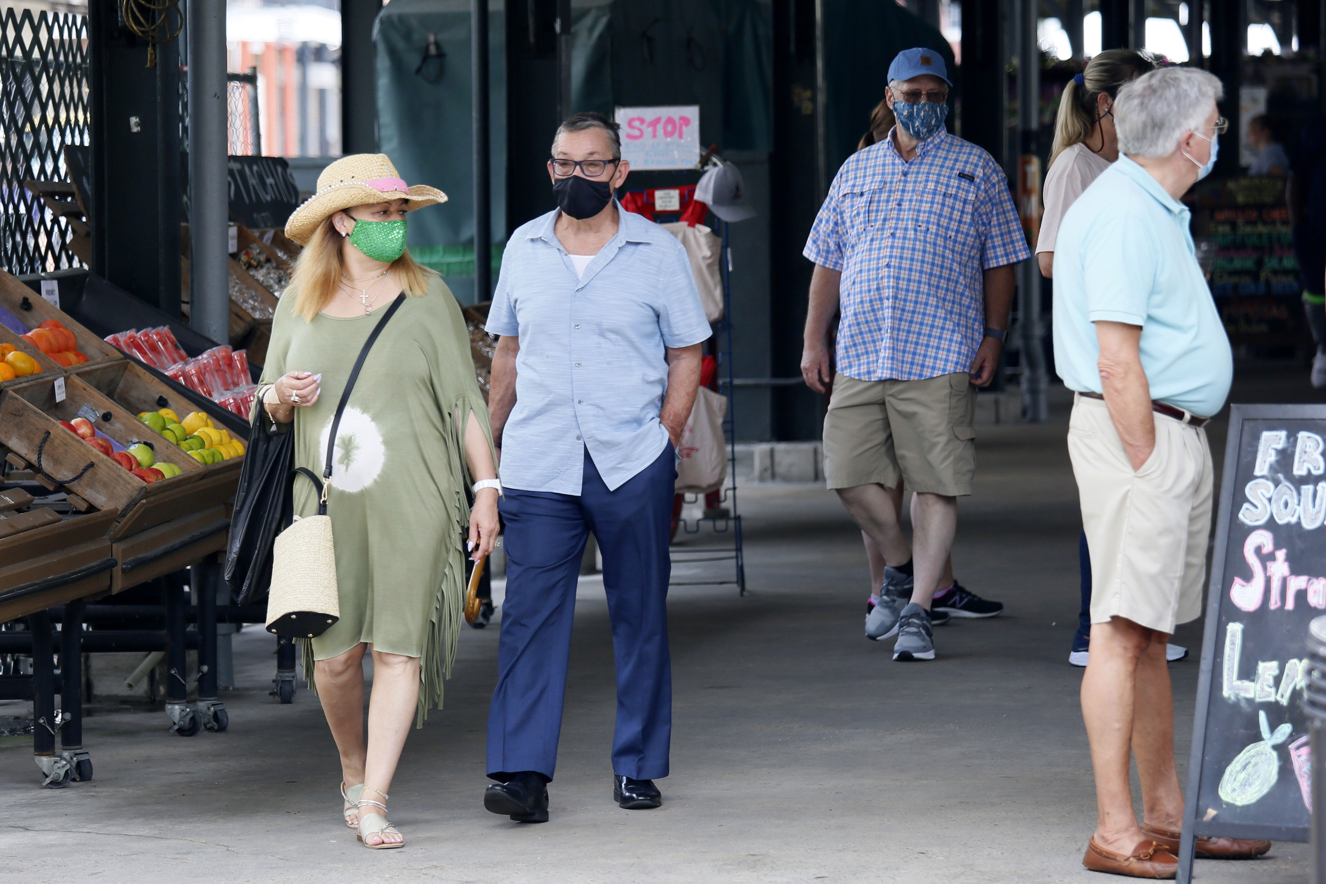 People visit a market in New Orleans on August 3, 2021.