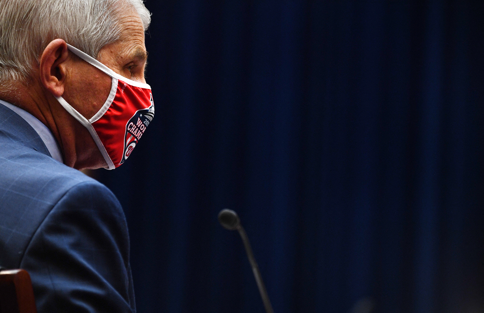 Dr. Anthony Fauci, director of the National Institute of Allergy and Infectious Diseases, wears a Washington Nationals protective mask during a hearing in Washington, DC on July 31.
